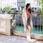 Fashion blogger Veronika Lipar of Brunette From Wall Street sharing how to wear short white bow socks, mini skirt and striped crop top on a cold spring day