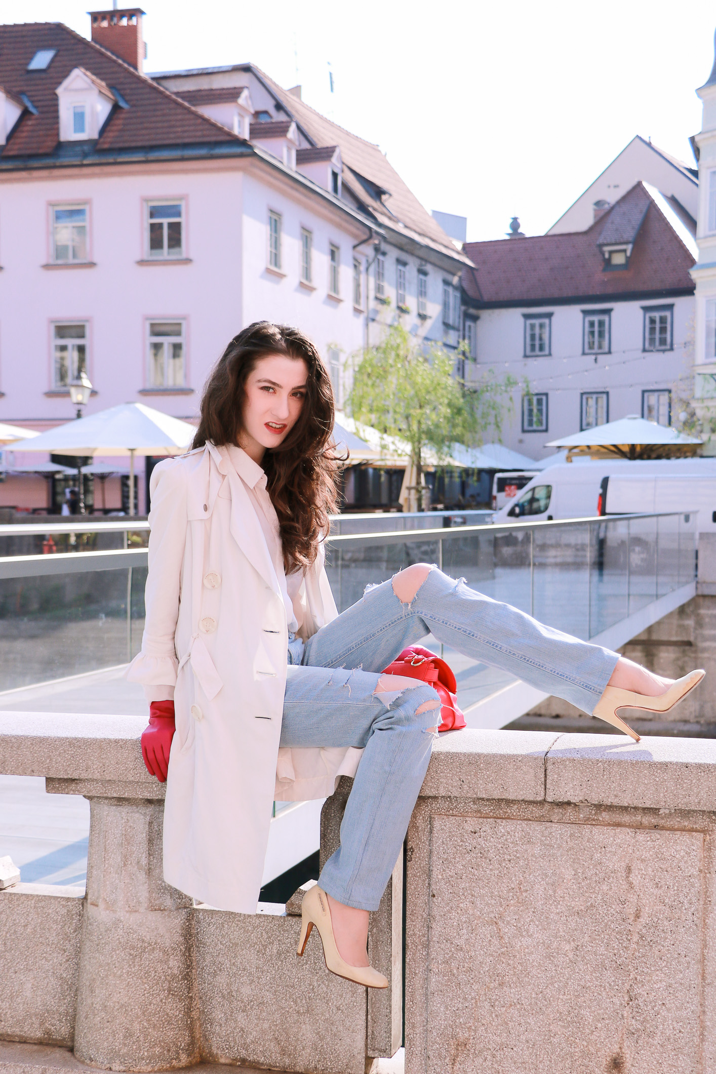 Fashion blogger Veronika Lipar of Brunette From Wall Street on her fears and loves while sitting on the edge of fence above the river