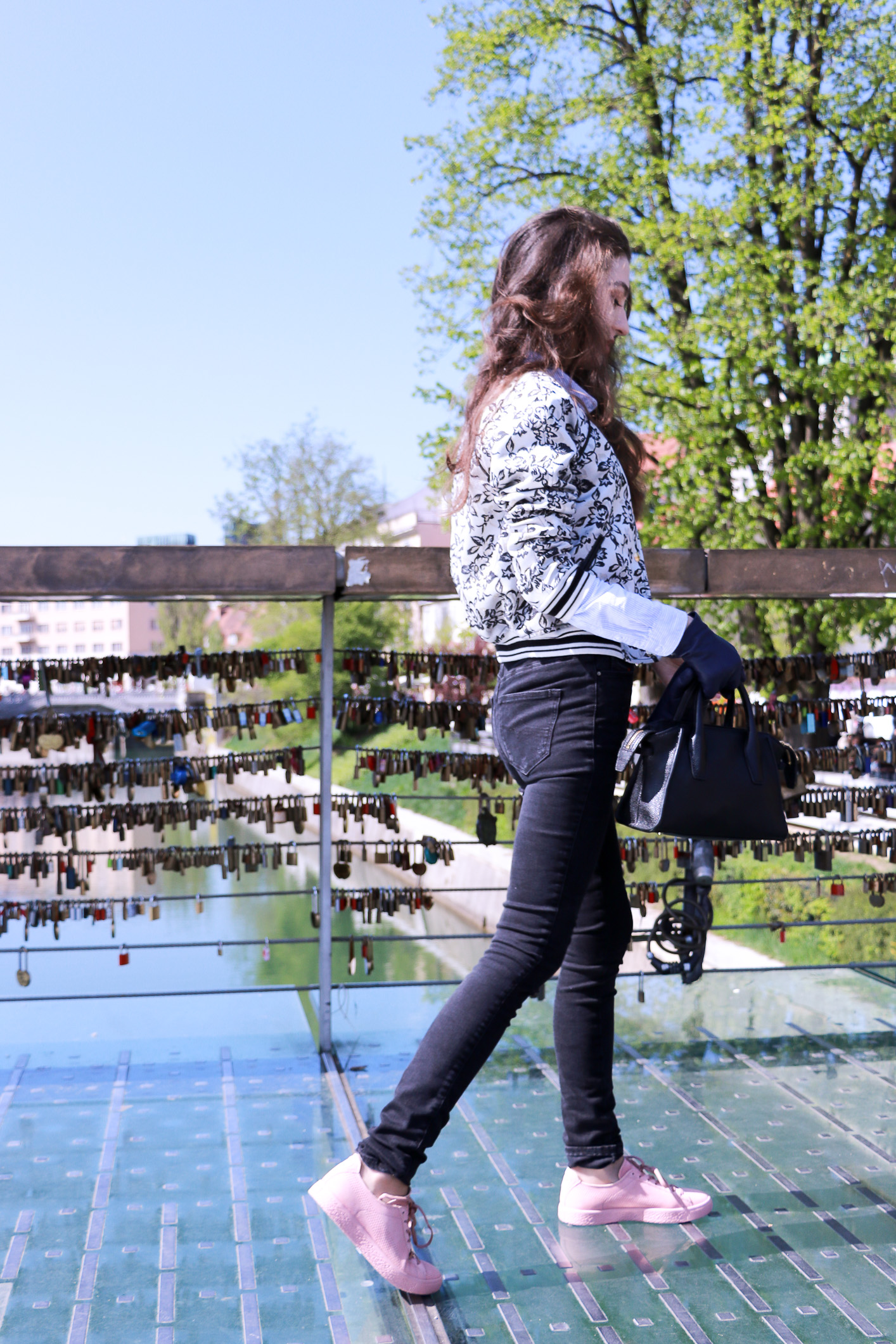 Fashion blogger Veronika Lipar of Brunette From Wall Street sharing how to wear dusty pink sneakers on Friday