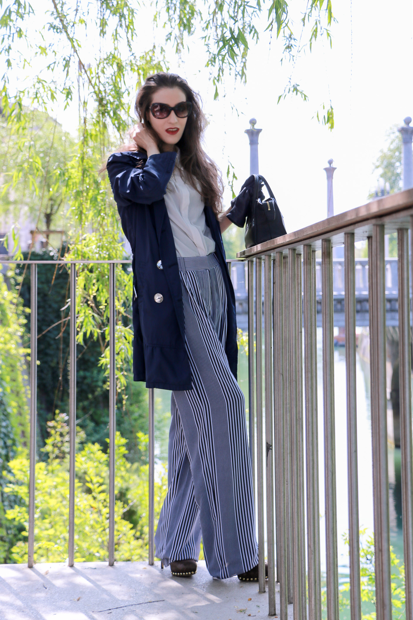 Fashion blogger Veronika Lipar of Brunette From Wall Street sharing how to style wide-leg striped pants for business casual look