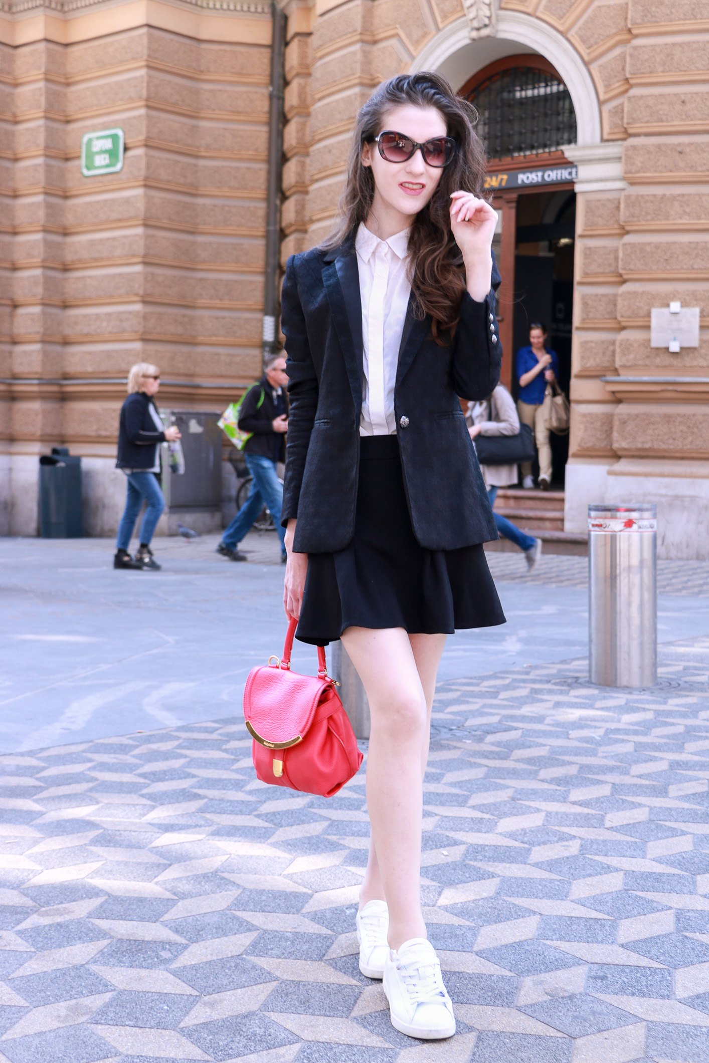 Fashion blogger Veronika Lipar of Brunette From Wall Street sharing her favourite skater skirt outfits to wear on the weekend