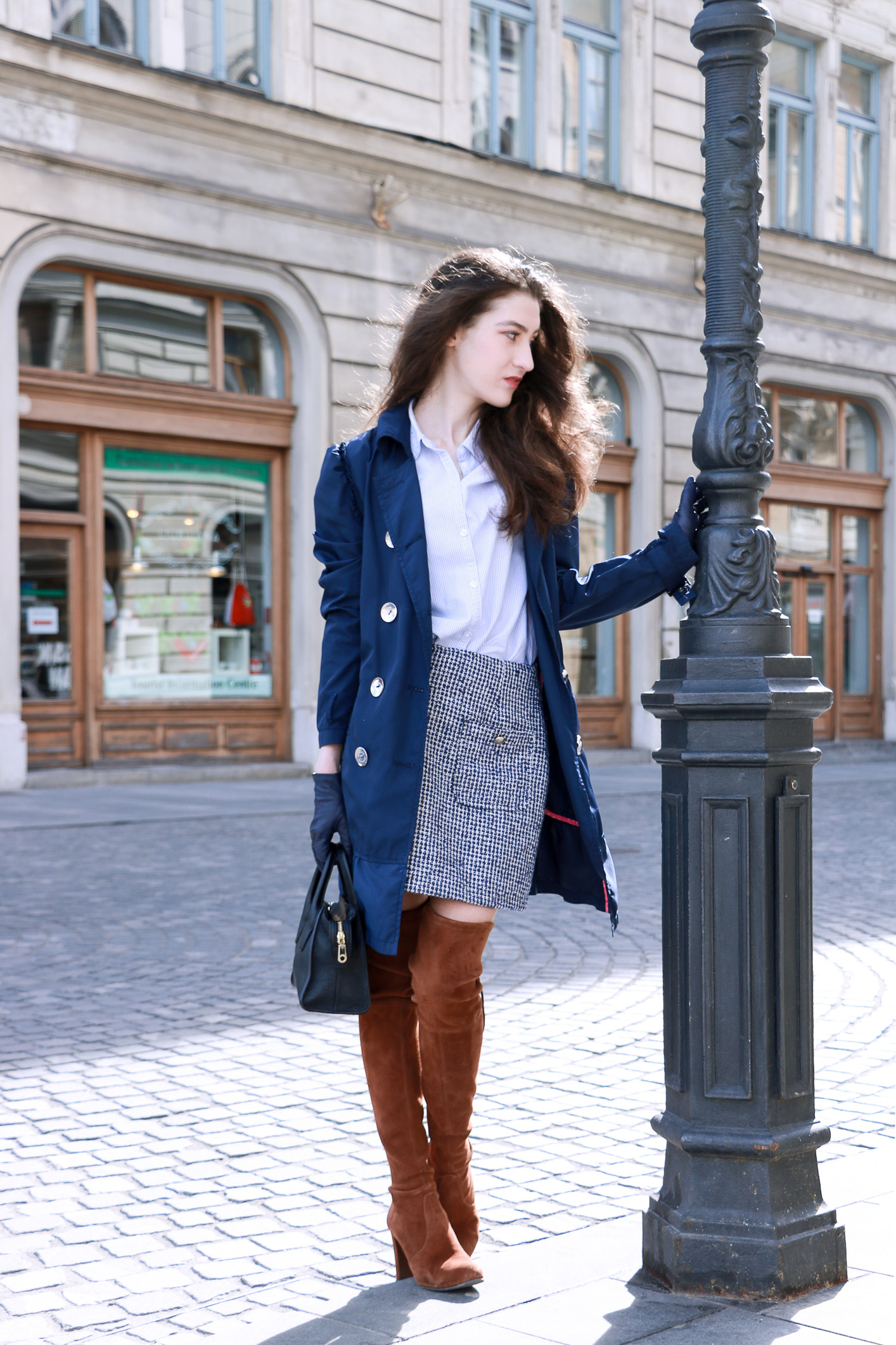 Fashion blogger Veronika Lipar of Brunette From Wall Street sharing how to style over the knee boots in spring