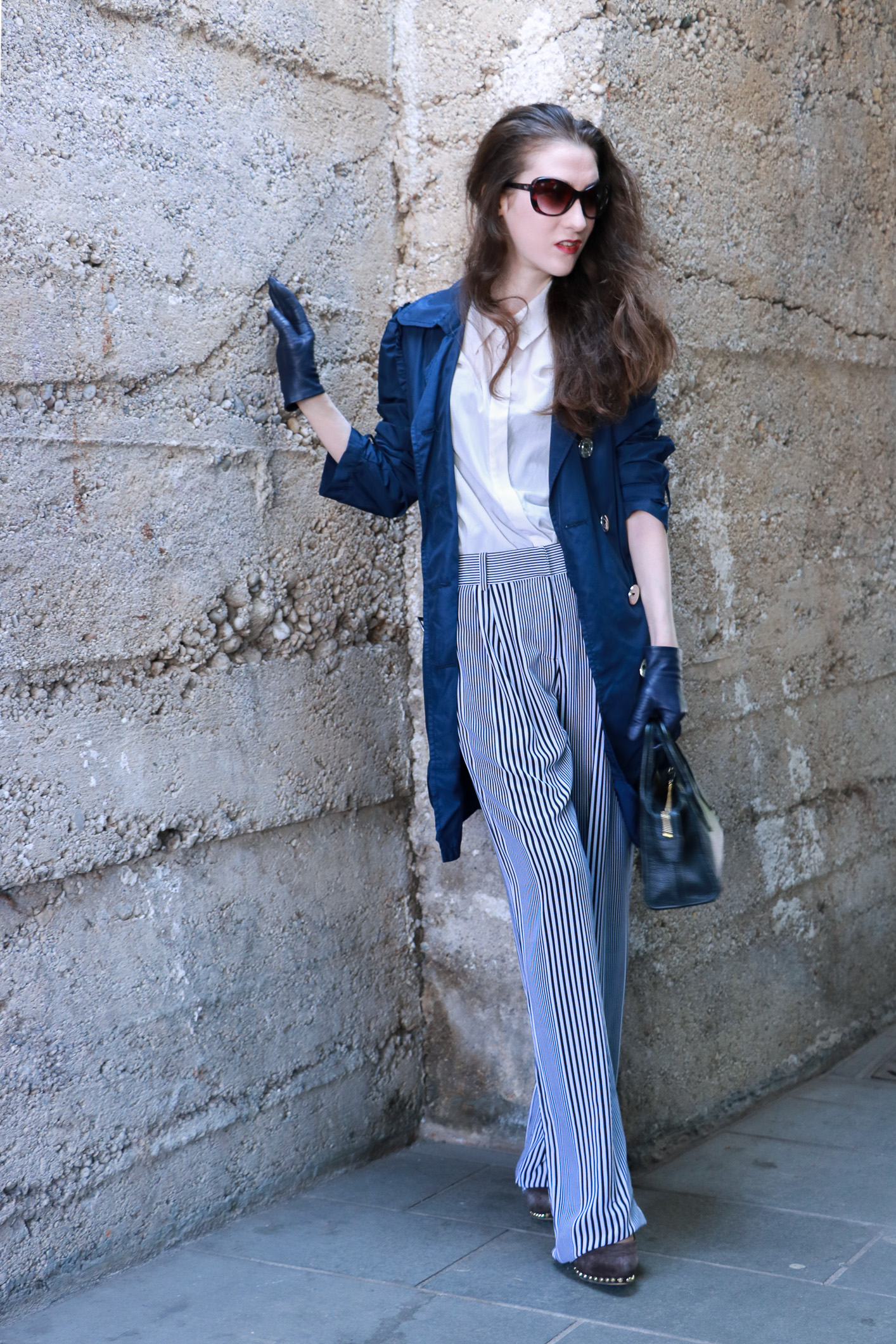 Fashion blogger Veronika Lipar of Brunette From Wall Street sharing how to wear wide-leg pants with stripes for a chic look this spring