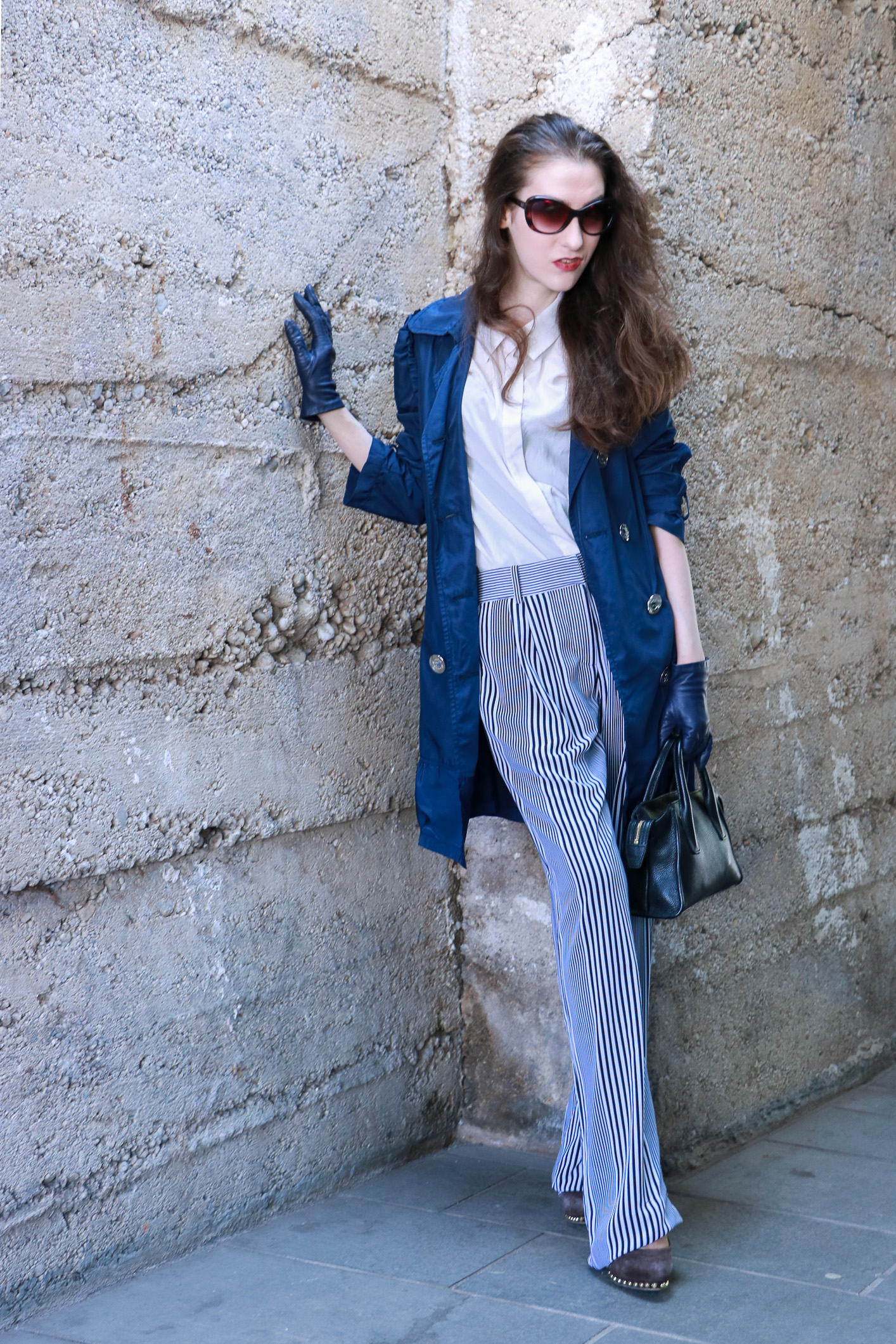Fashion blogger Veronika Lipar of Brunette From Wall Street sharing how to wear wide-leg pants with stripes for a chic style this spring