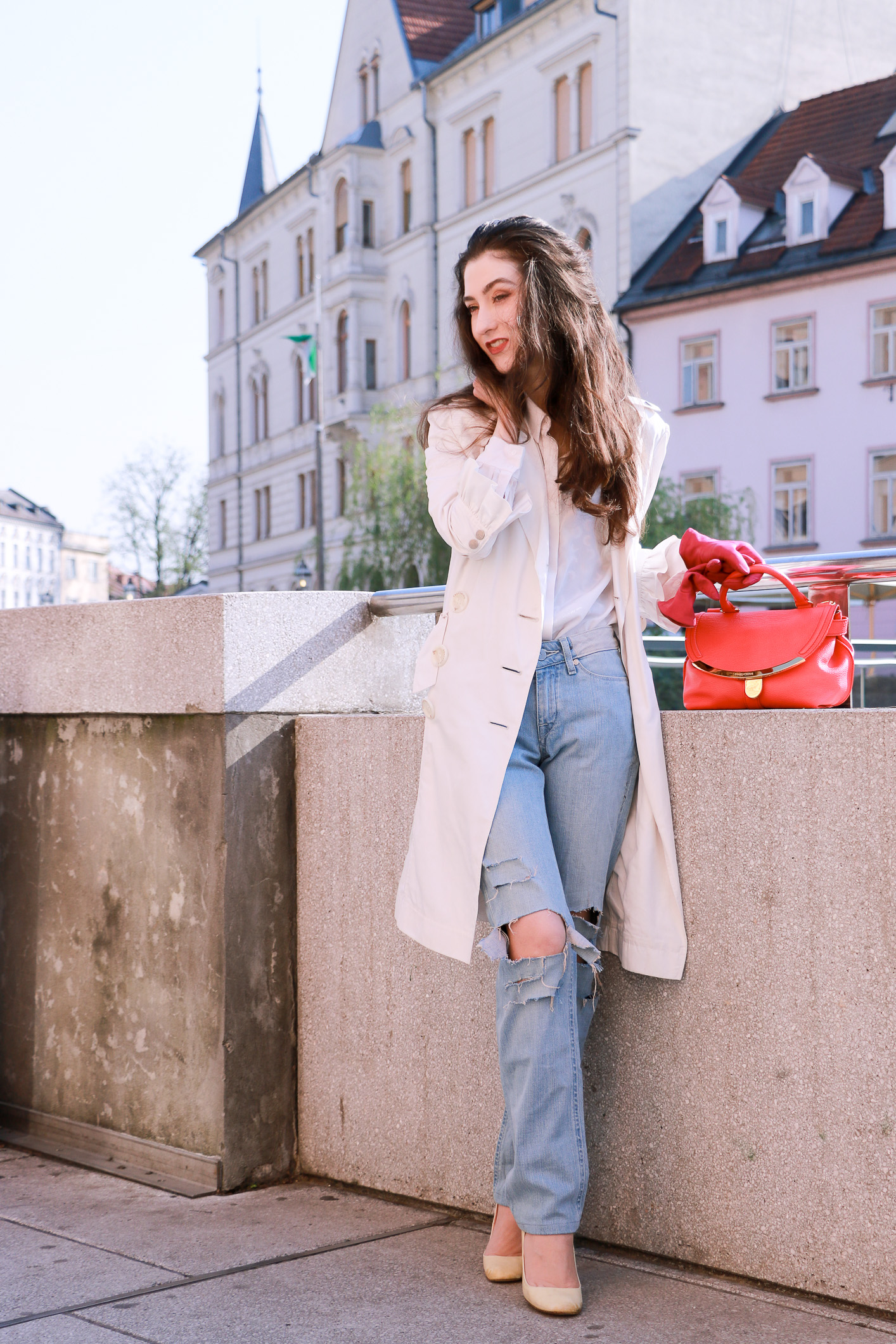 Fashion blogger Veronika Lipar of Brunette From Wall Street sharing her sexy street style in light blue ripped jeans and white heels