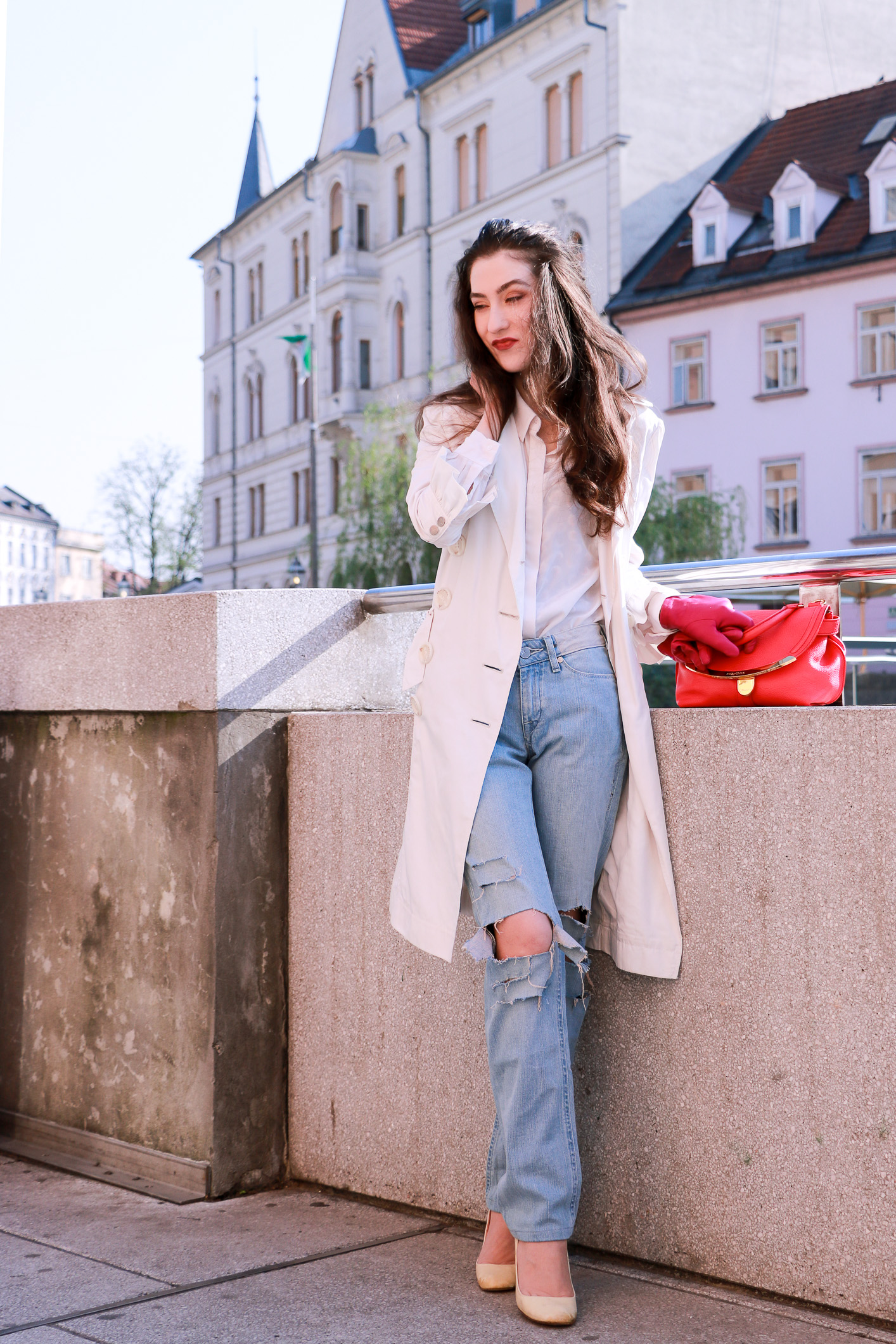 Fashion blogger Veronika Lipar of Brunette From Wall Street sharing how to wear white long trench coat for a chic casual style