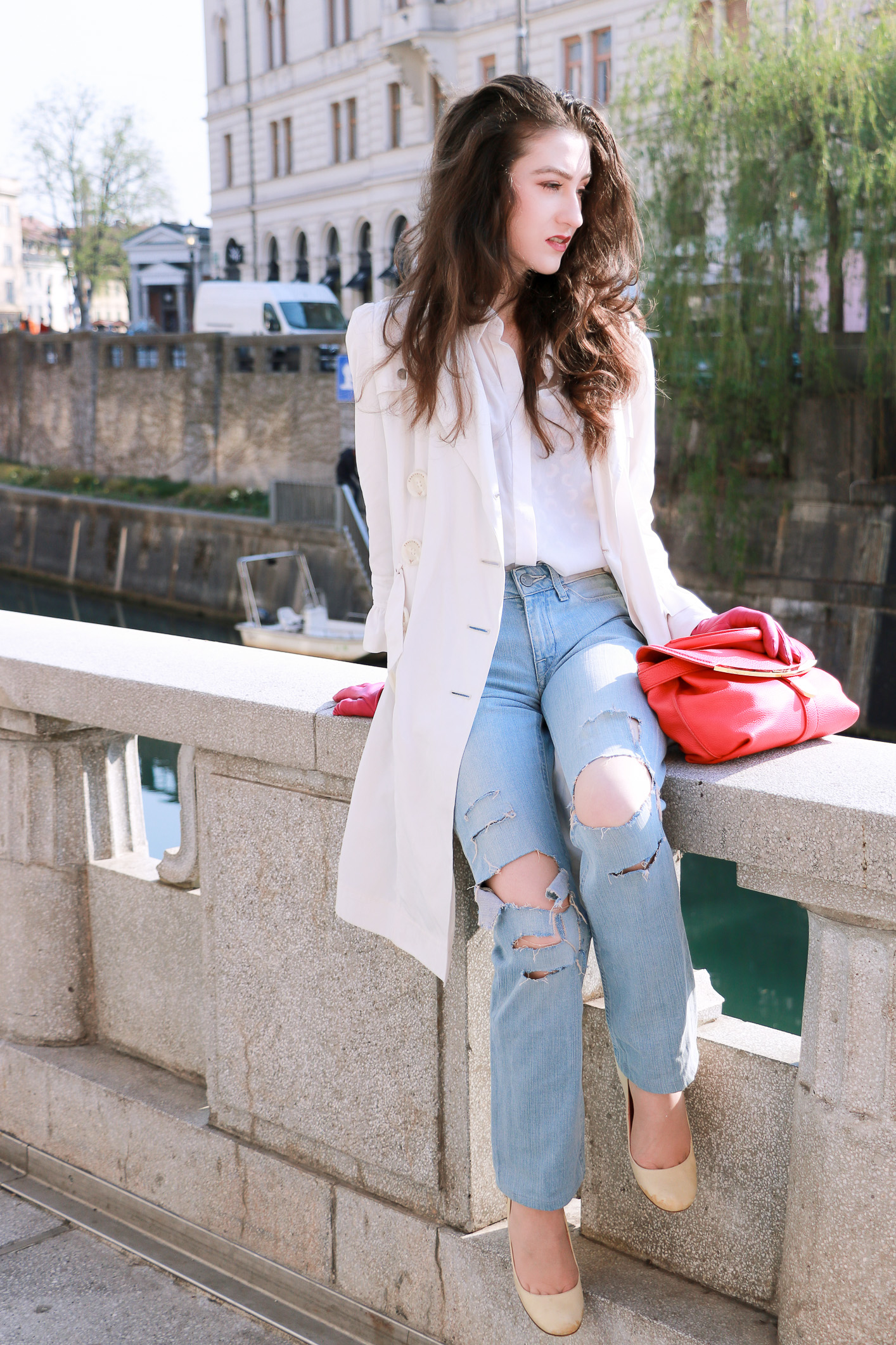 Fashion blogger Veronika Lipar of Brunette From Wall Street sharing how to wear white pumps and hot pink bag