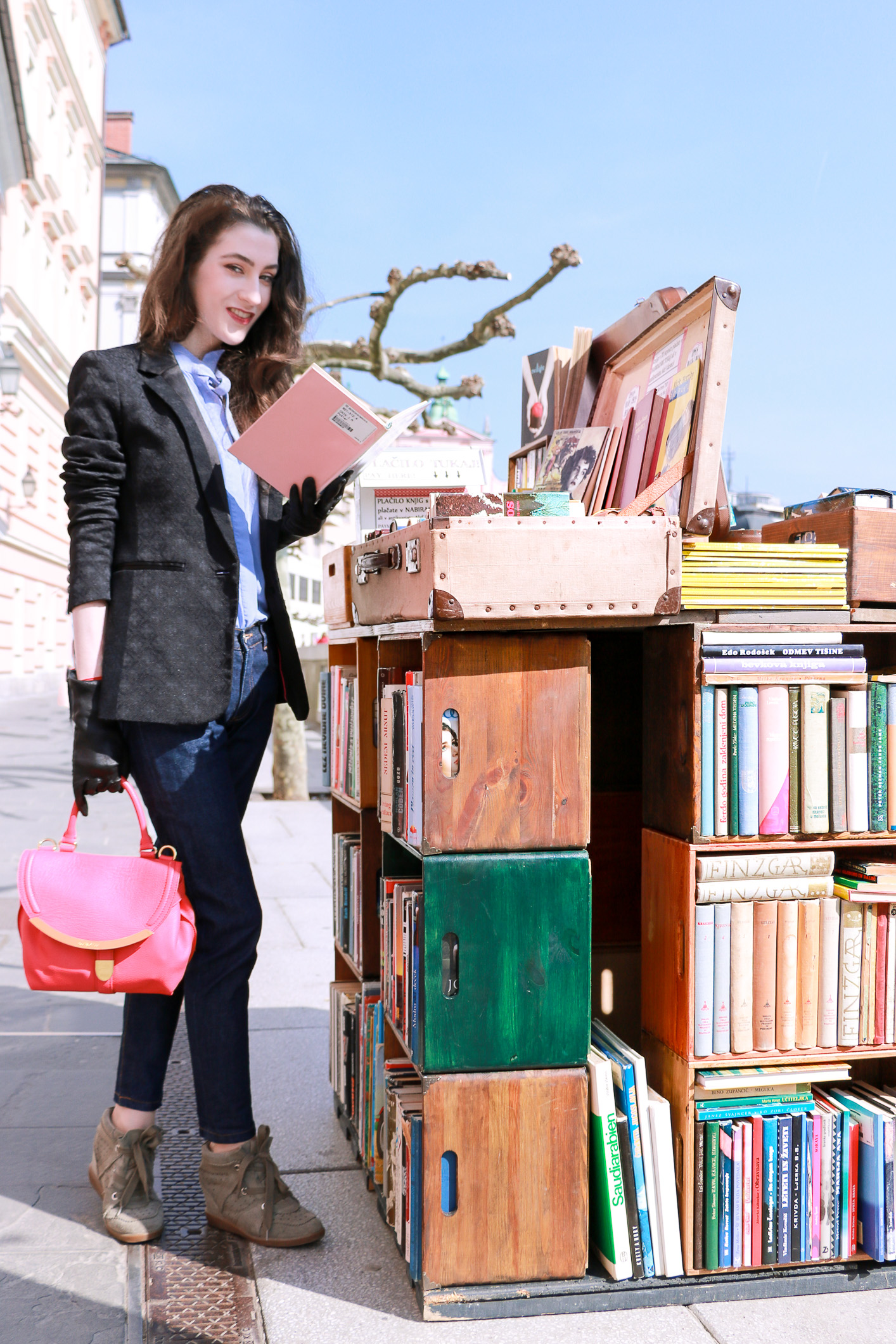 Fashion blogger Veronika Lipar of Brunette From Wall Street reading a classic book on the street