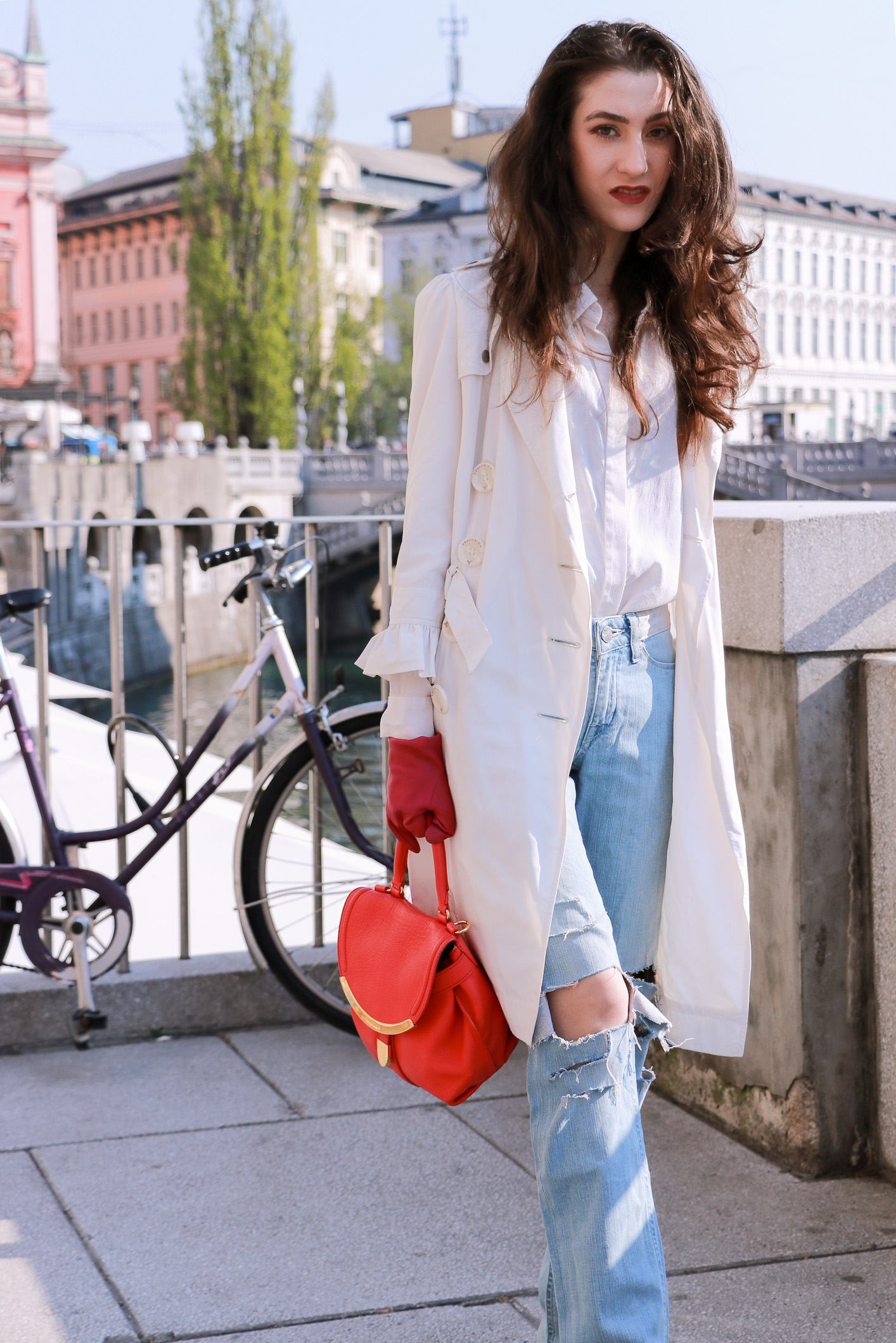 Fashion blogger Veronika Lipar of Brunette From Wall Street sharing how to style white trench coat