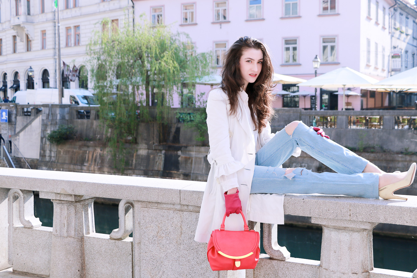 Fashion blogger Veronika Lipar of Brunette From Wall Street sharing her chic casual street style in light blue ripped jeans and white heels