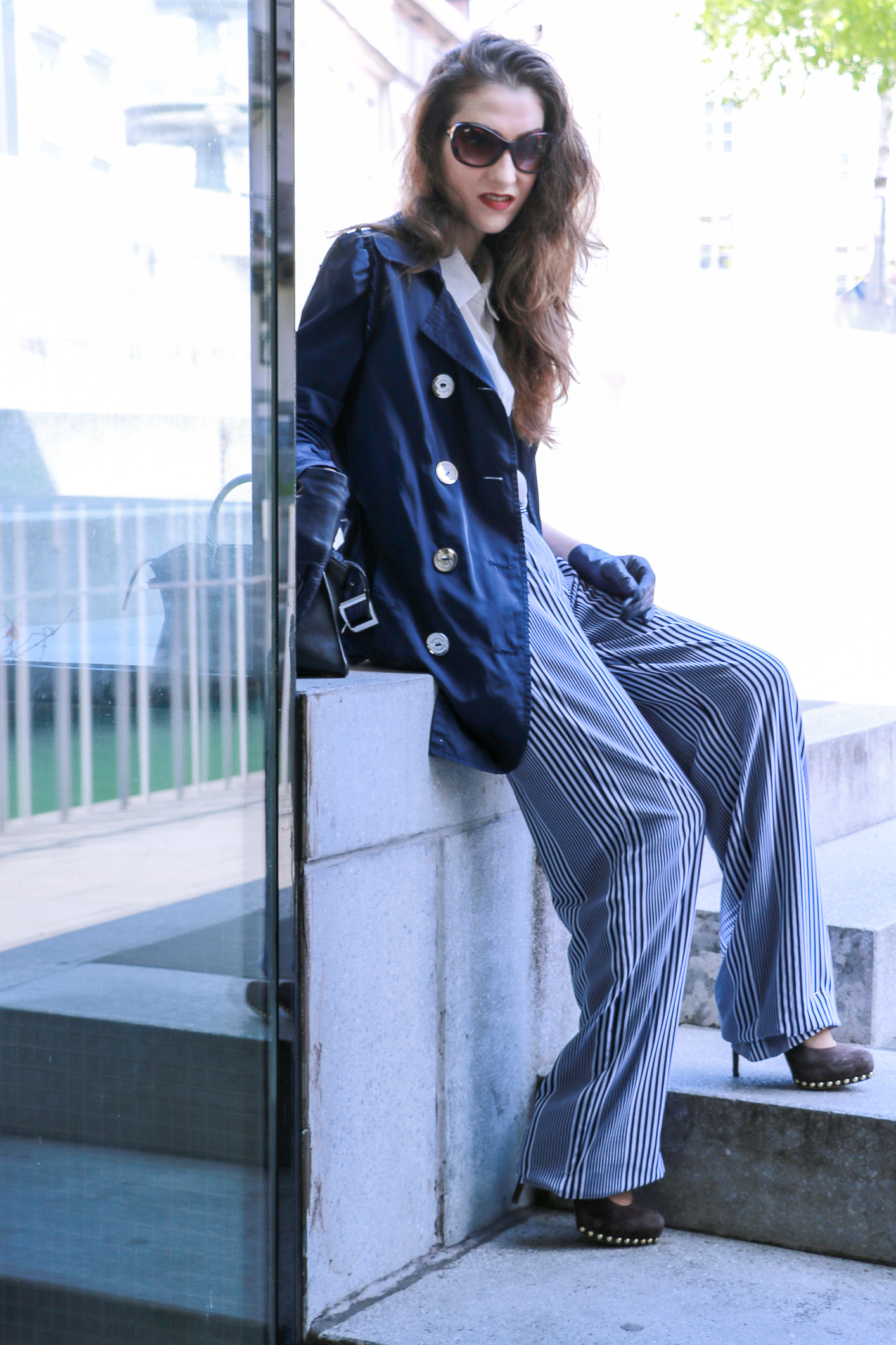 Fashion blogger Veronika Lipar of Brunette From Wall Street sharing how to wear wide-leg trousers with stripes for a chic casual look this spring