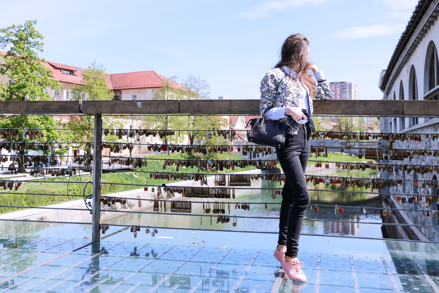 Fashion blogger Veronika Lipar of Brunette From Wall Street sharing how to style pale pink sneakers for the weekend
