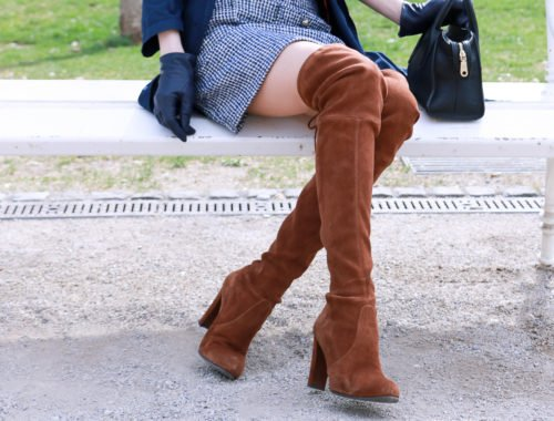 Fashion blogger Veronika Lipar of Brunette From Wall Street sharing how to wear over the knee boots in spring