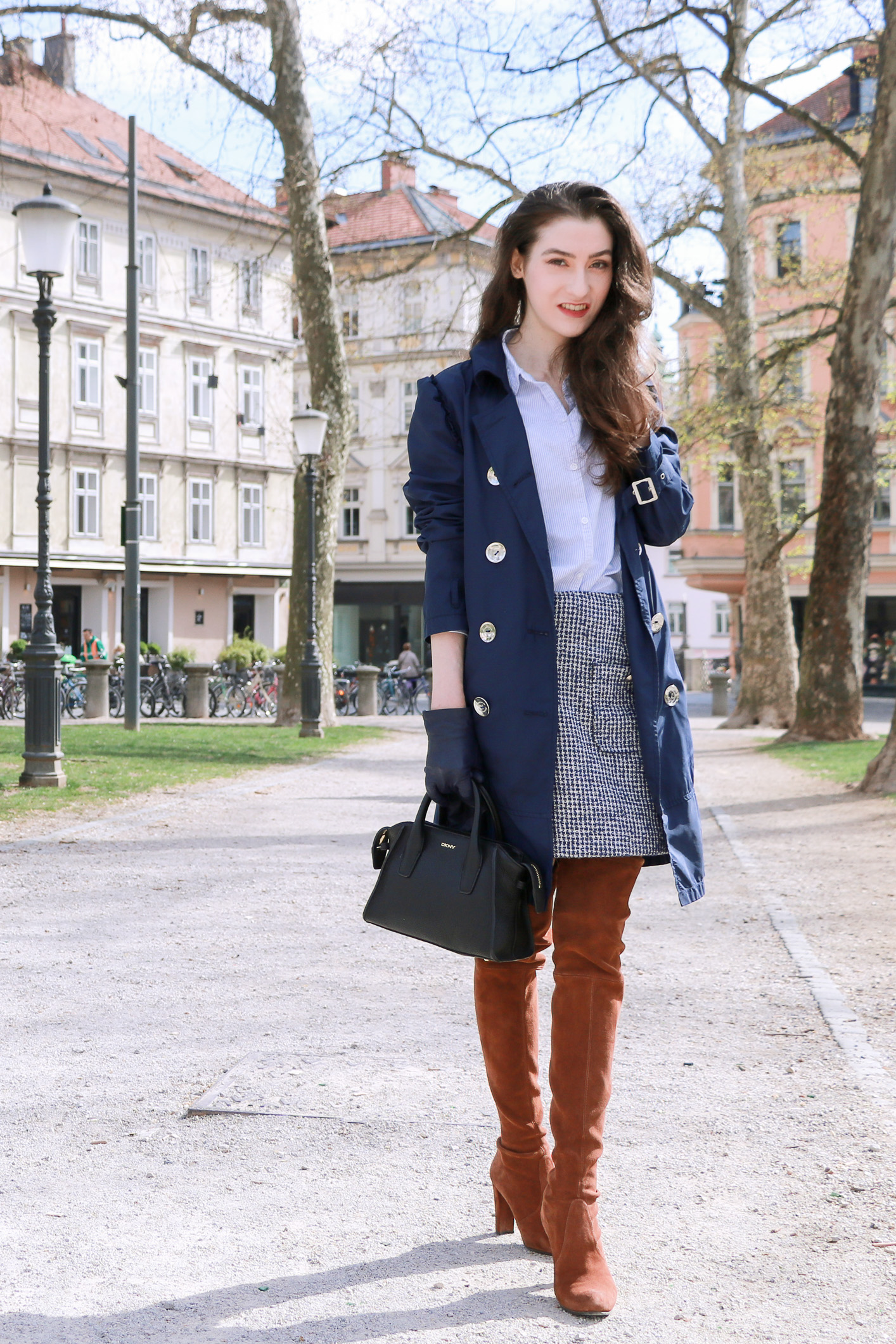 Fashion blogger Veronika Lipar of Brunette From Wall Street sharing how to wear OTK boots in spring