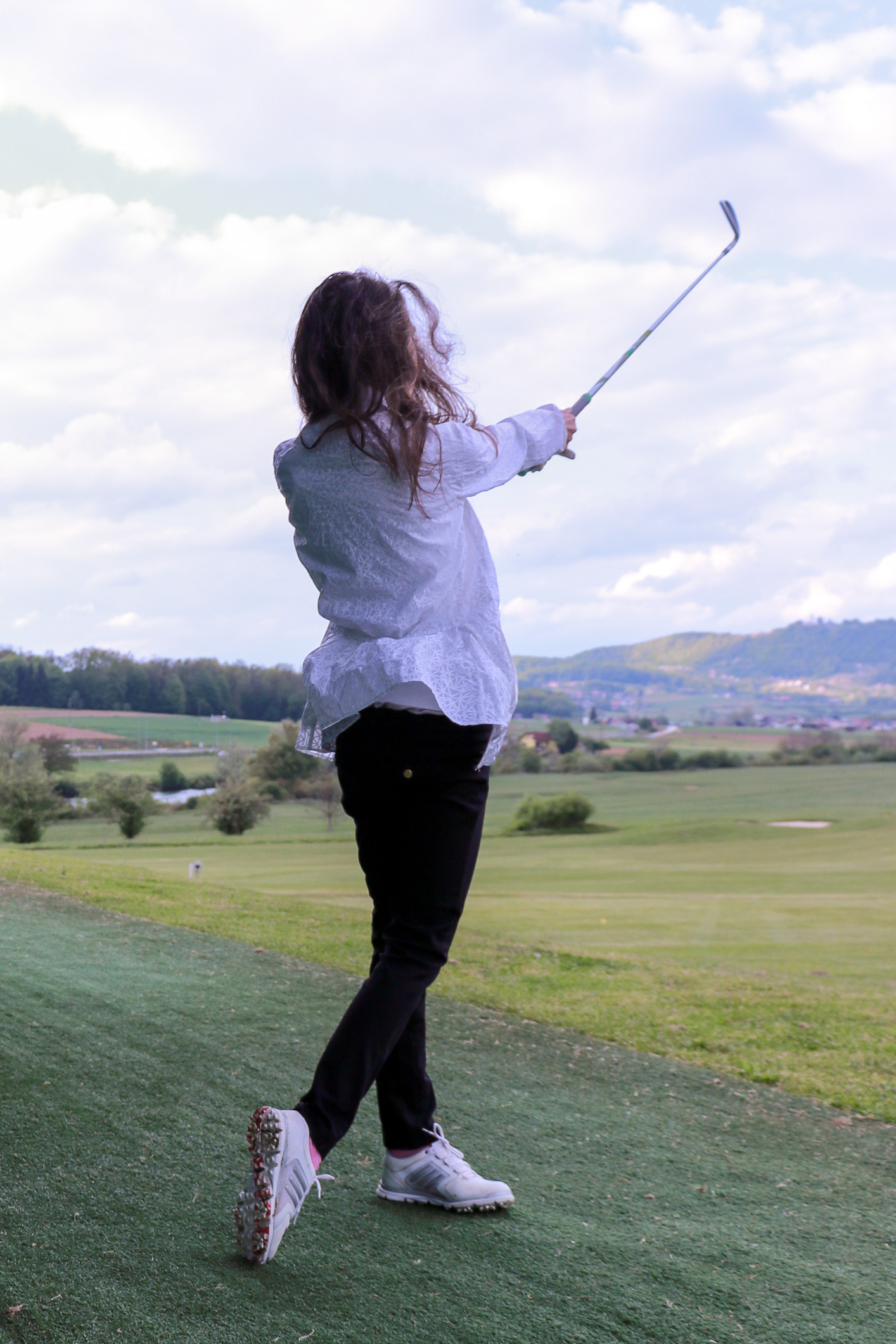 Fashion blogger Veronika Lipar of Brunette From Wall Street sharing best golf outfits for ladies