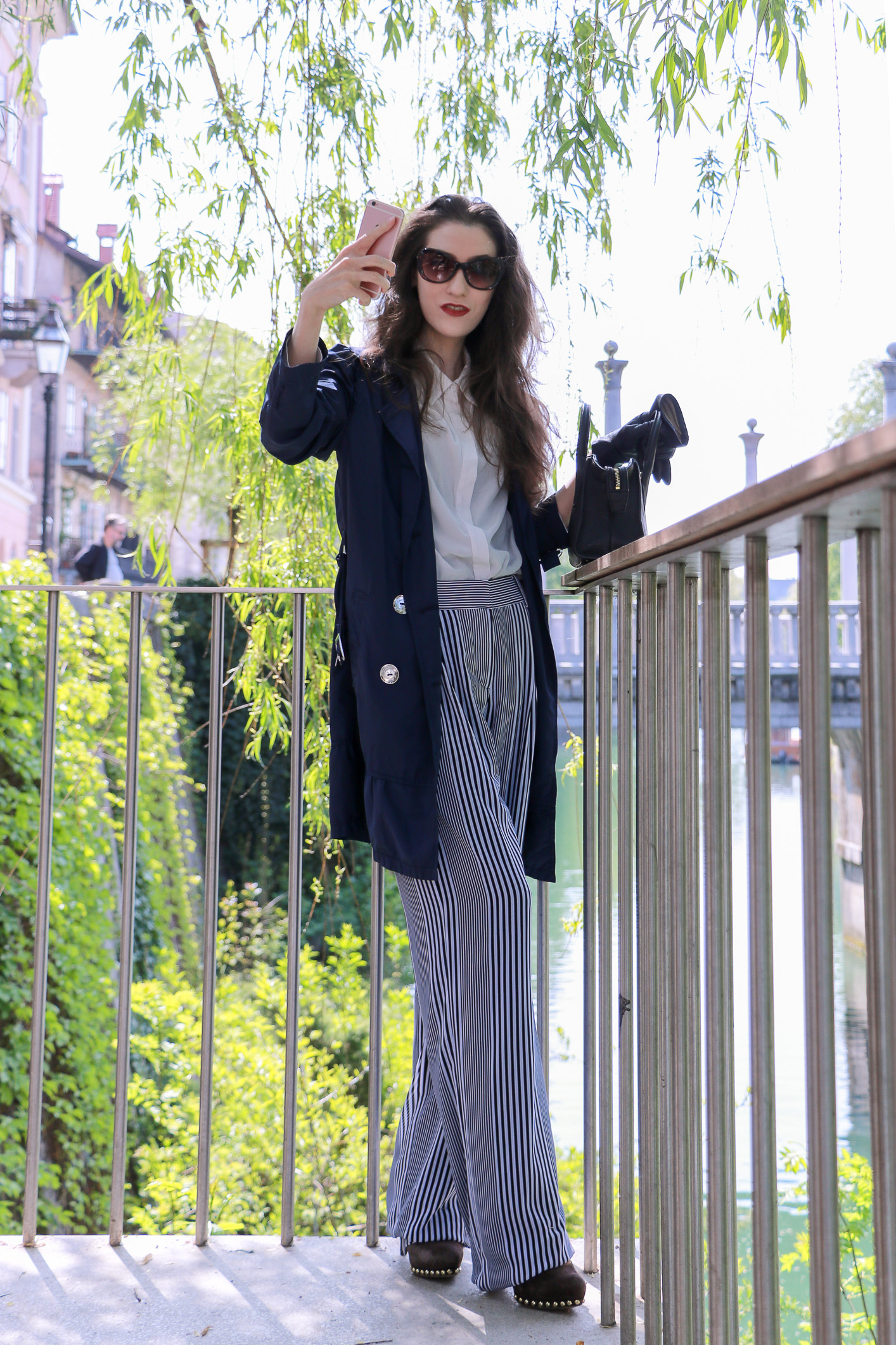 Fashion blogger Veronika Lipar of Brunette From Wall Street sharing how to wear wide-leg striped pants for a chic look this spring