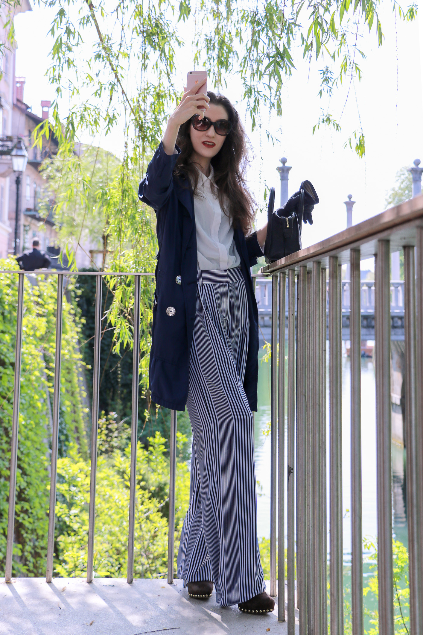 Fashion blogger Veronika Lipar of Brunette From Wall Street sharing how to wear wide-leg striped trousers for a chic style this spring