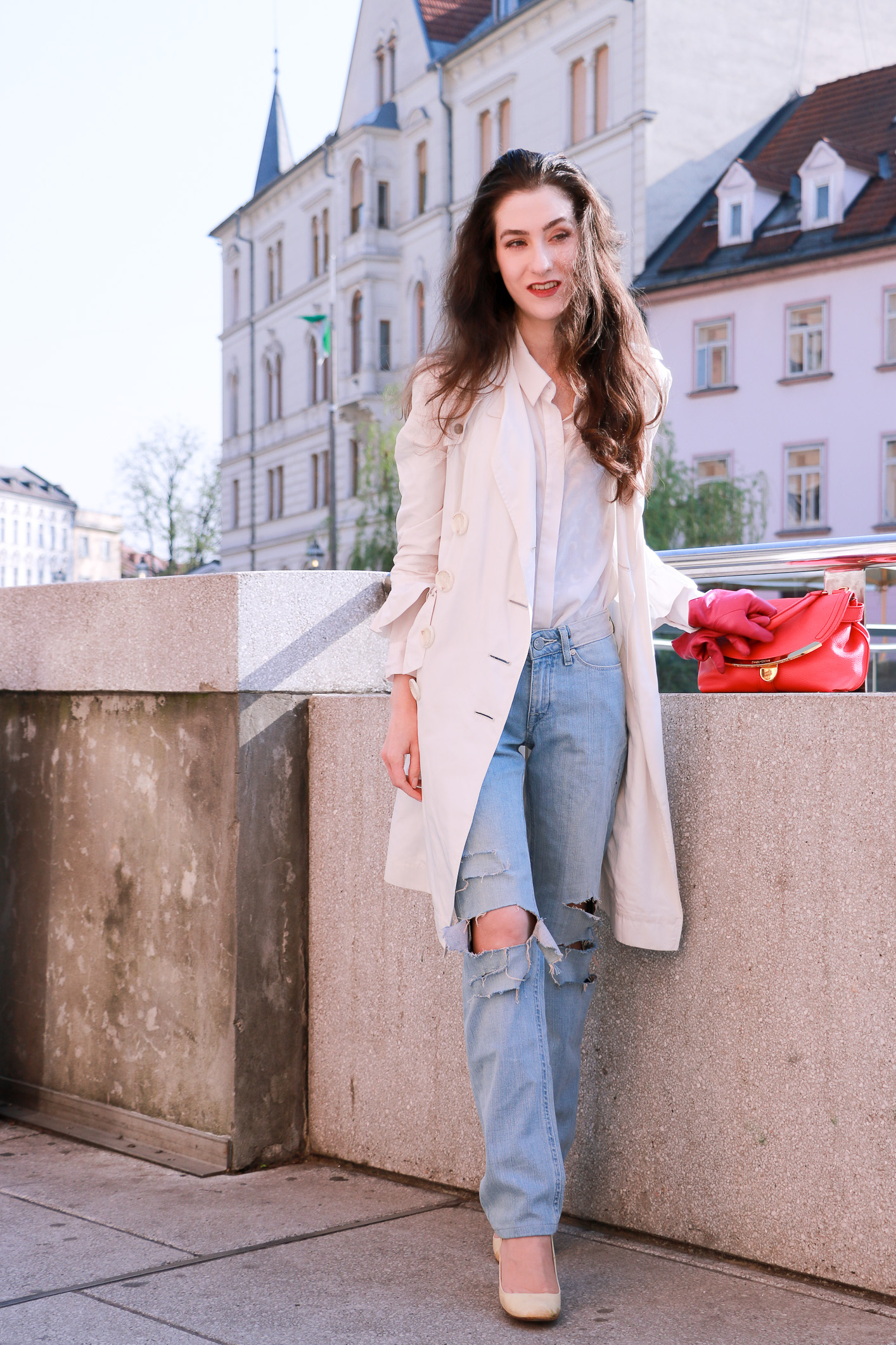Fashion blogger Veronika Lipar of Brunette From Wall Street sharing how to style white heels and ripped jeans