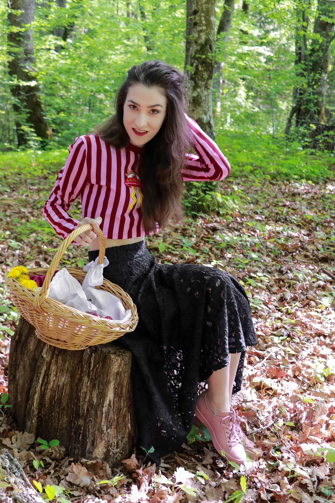 Fashion blogger Veronika Lipar of Brunette From Wall Street on how to wear pink and red striped cropped top, black midi skirt and pink pale sneakers for Easter brunch