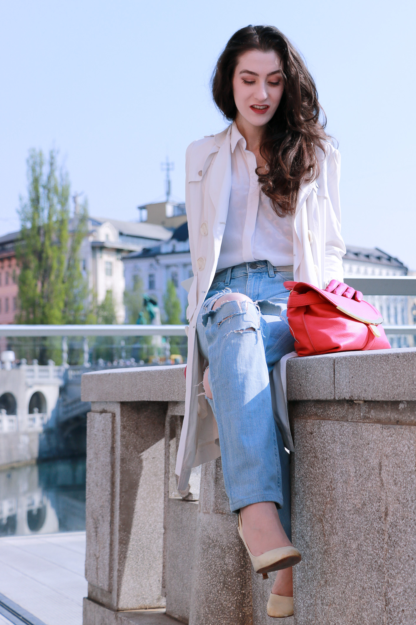 Fashion blogger Veronika Lipar of Brunette From Wall Street sharing how to wear ripped jeans this spring