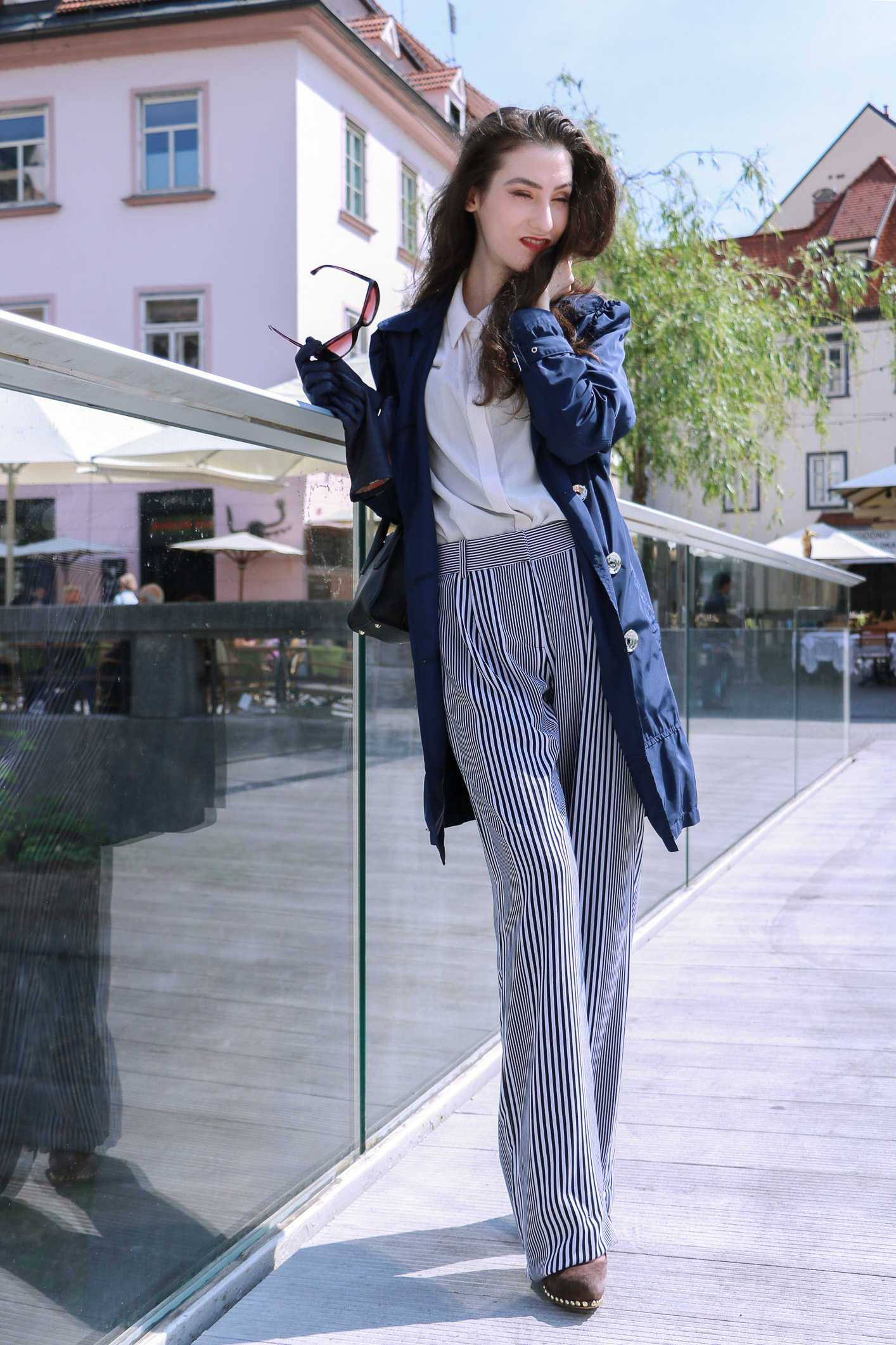 Fashion blogger Veronika Lipar of Brunette From Wall Street sharing how to style wide-leg striped trousers for a chic style this spring