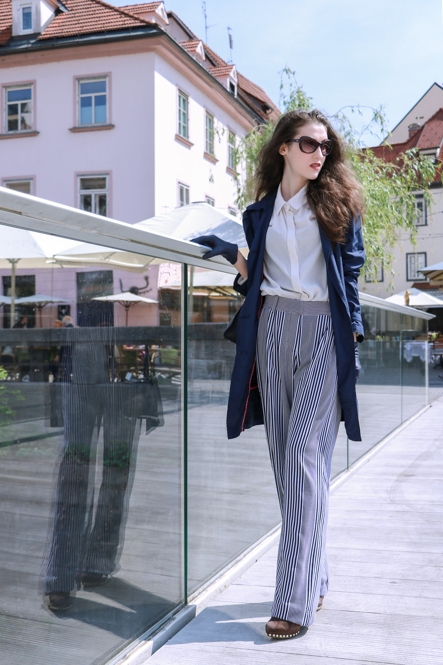Fashion blogger Veronika Lipar of Brunette From Wall Street sharing how to wear wide-leg striped pants for a chic style this spring