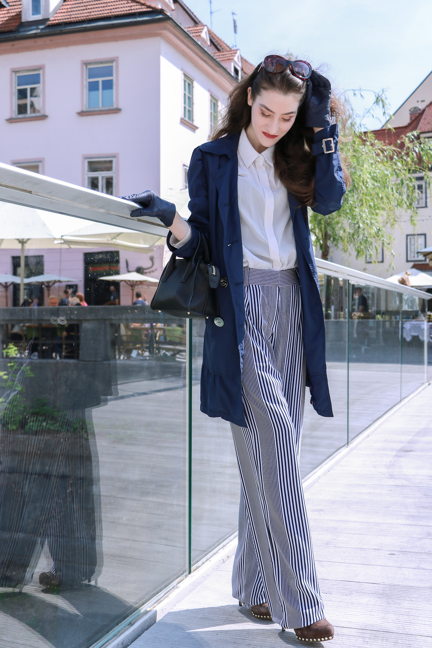 Fashion blogger Veronika Lipar of Brunette From Wall Street sharing how to style wide-leg striped trousers for a chic look this spring