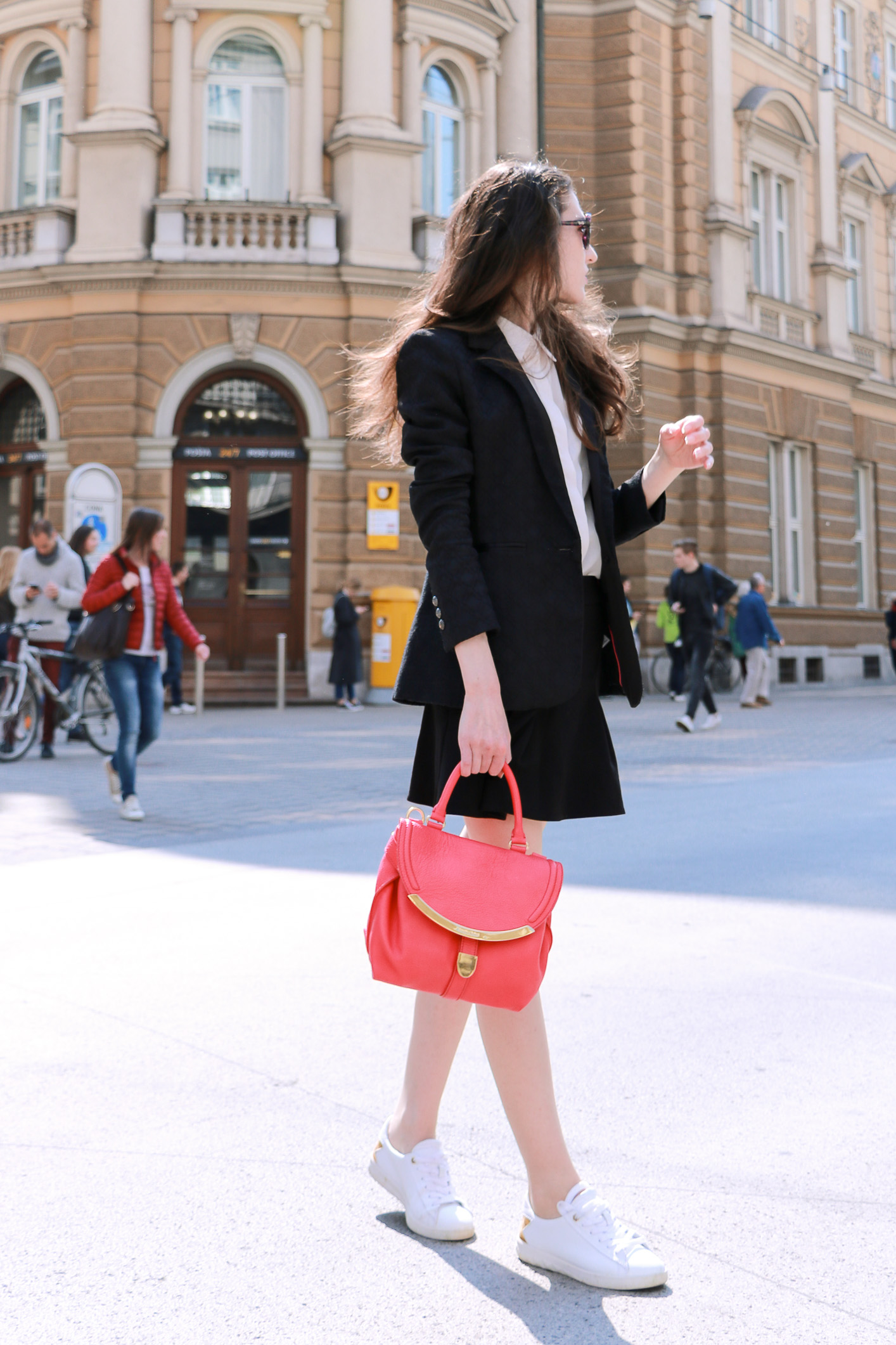 Fashion blogger Veronika Lipar of Brunette From Wall Street sharing how to dress like a Parisian this spring