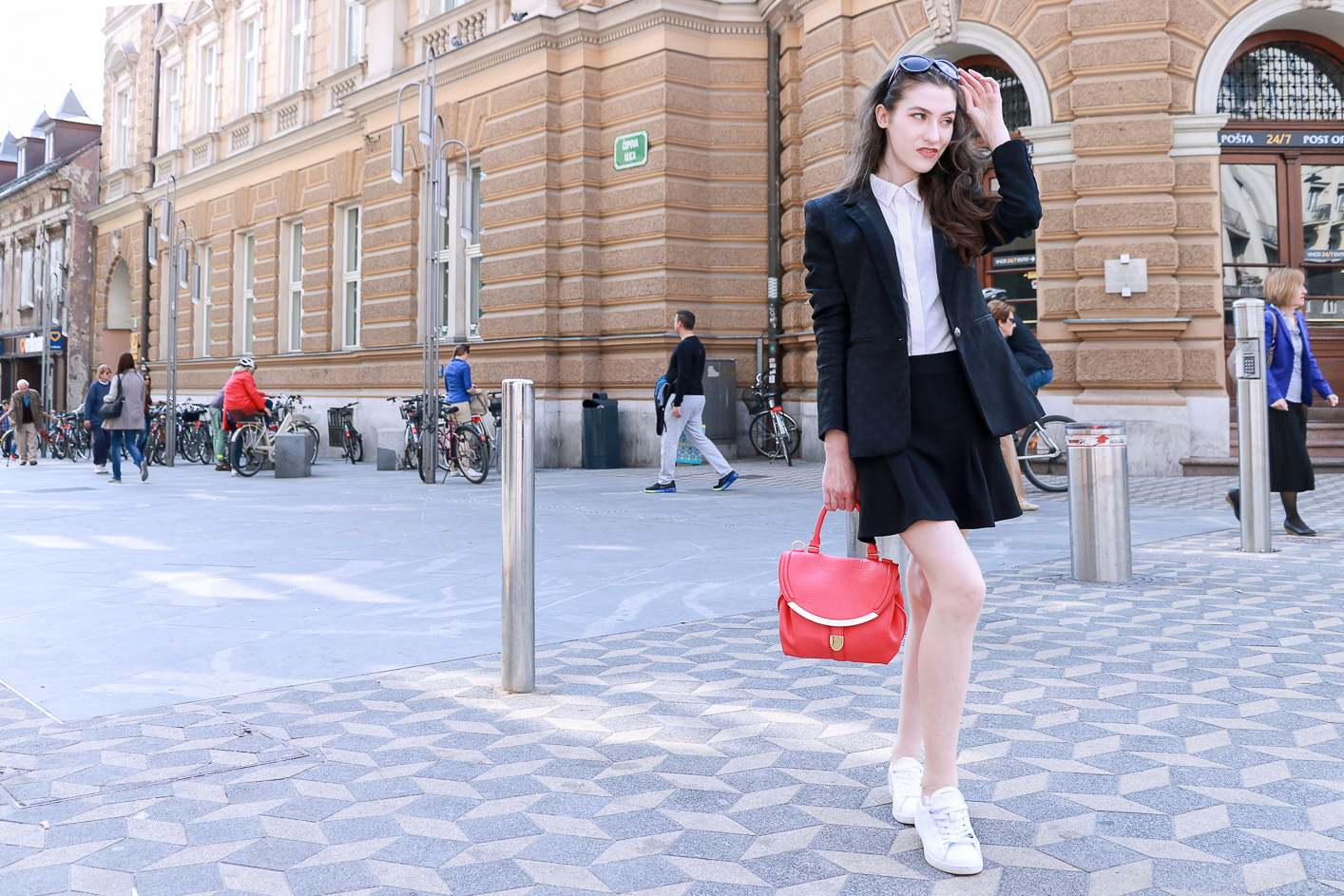 Fashion blogger Veronika Lipar of Brunette From Wall Street sharing how to wear black and white outfits on a sunny spring day