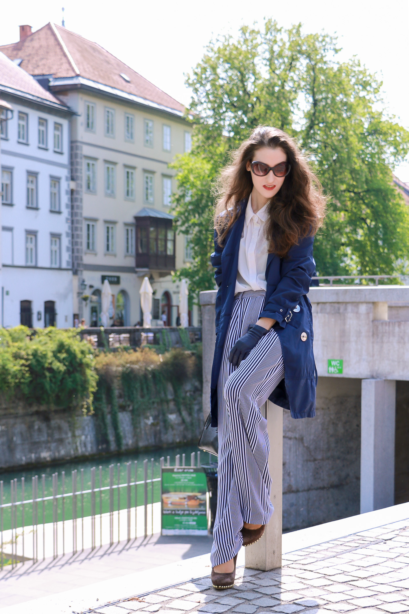 Fashion blogger Veronika Lipar of Brunette From Wall Street sharing how to style wide-leg striped trousers for a business casual outfit