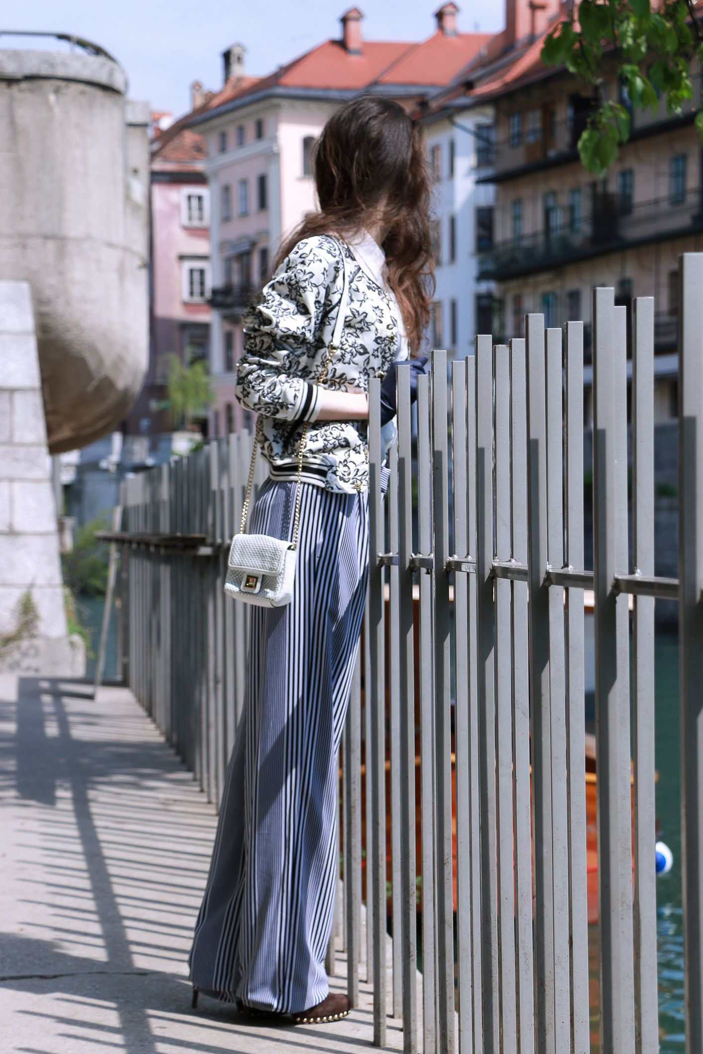 Fashion blogger Veronika Lipar of Brunette From Wall Street sharing how to look taller in wide-leg trousers