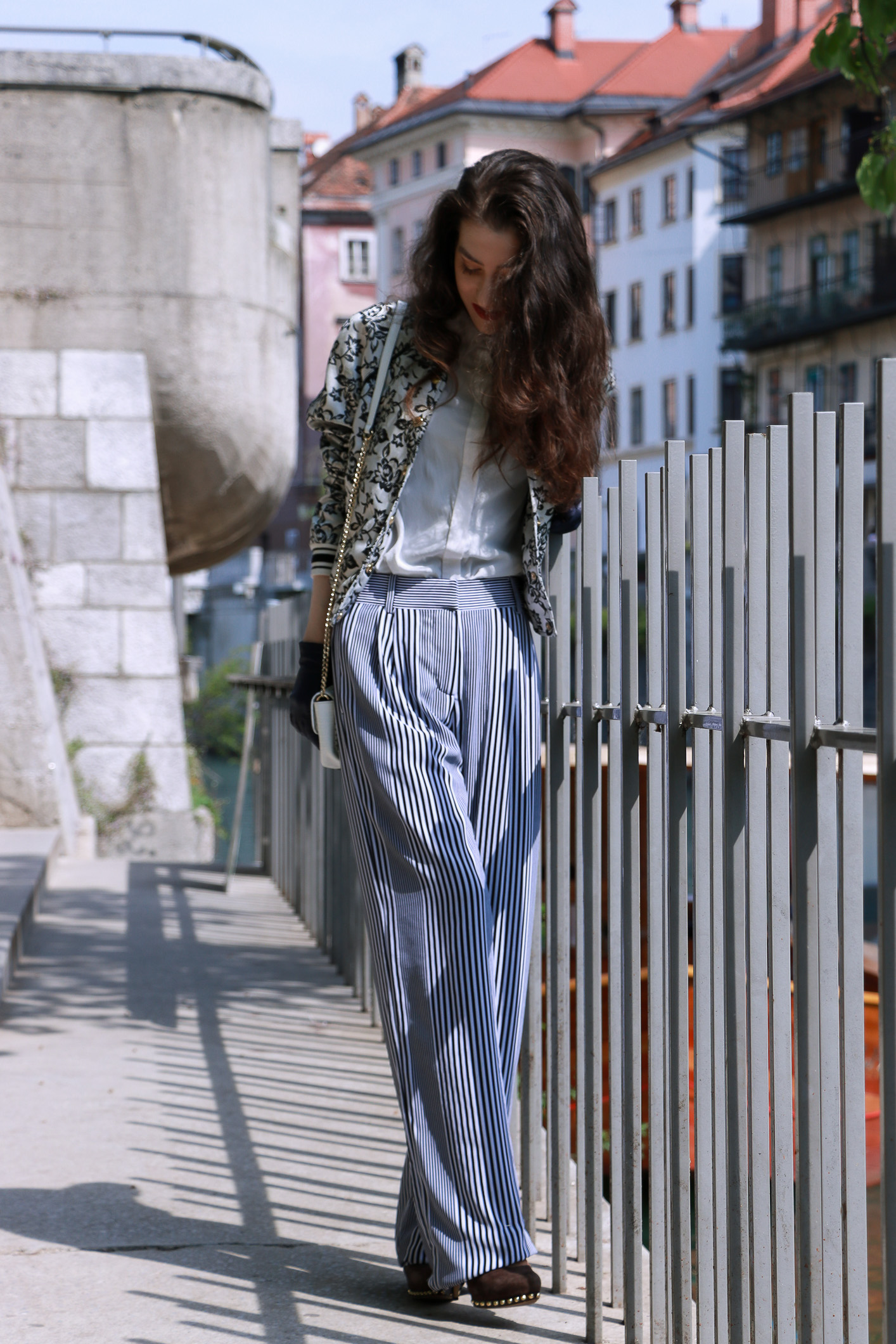 Fashion blogger Veronika Lipar of Brunette From Wall Street sharing how to wear the wide-leg pants to look taller