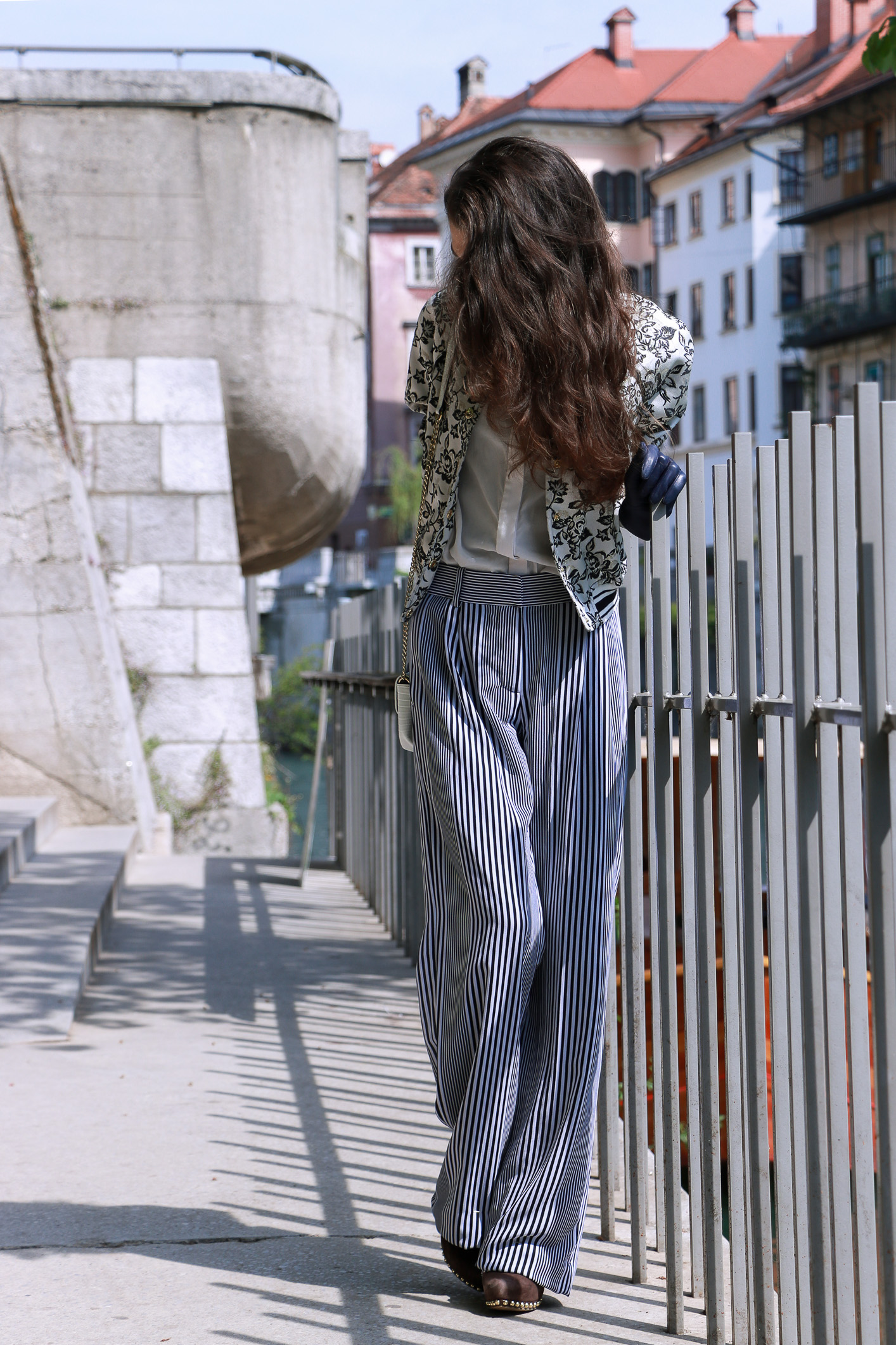 Fashion blogger Veronika Lipar of Brunette From Wall Street sharing how to style the wide-leg pants to look taller