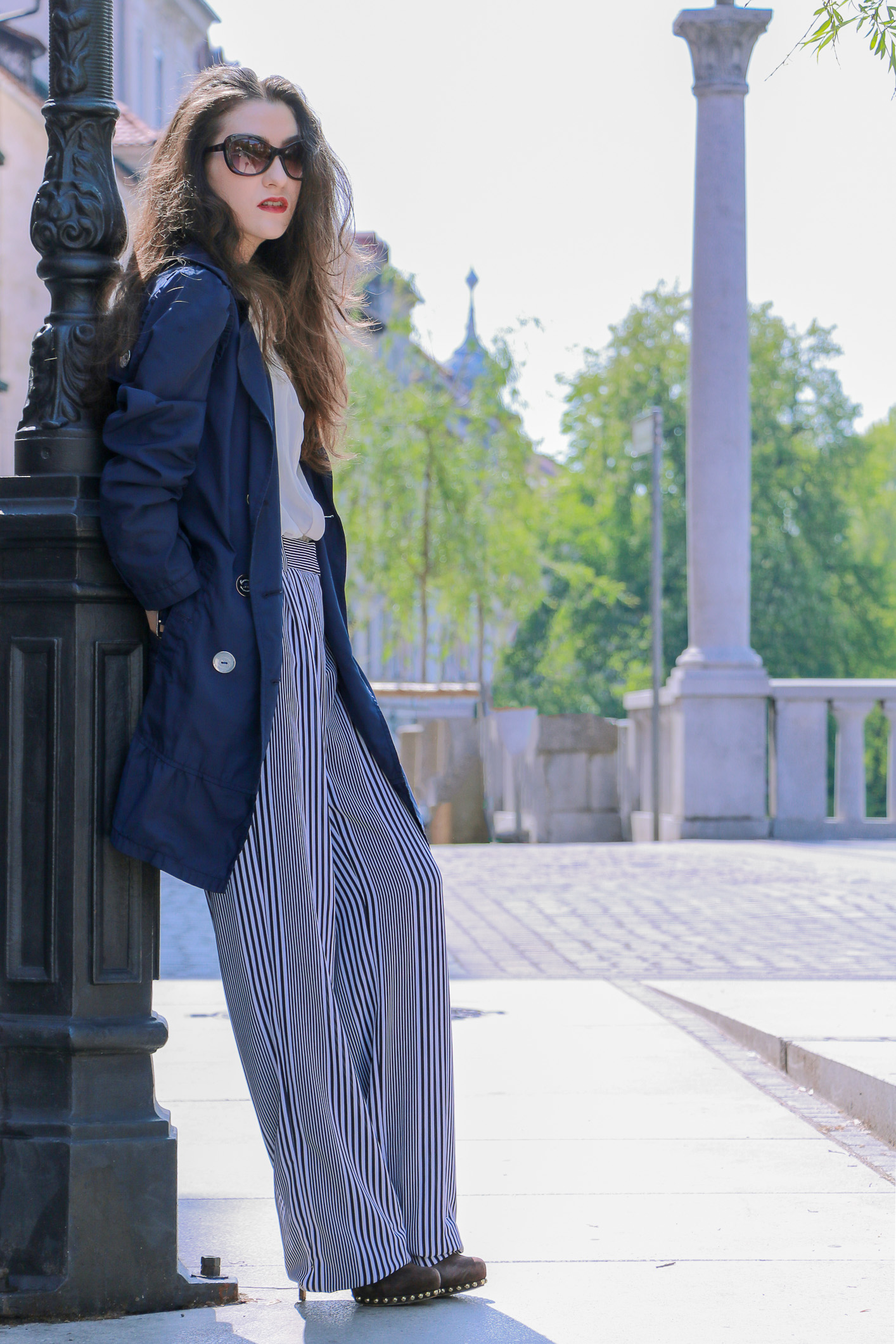 Fashion blogger Veronika Lipar of Brunette From Wall Street sharing how to style wide-leg striped pants for a chic look this spring