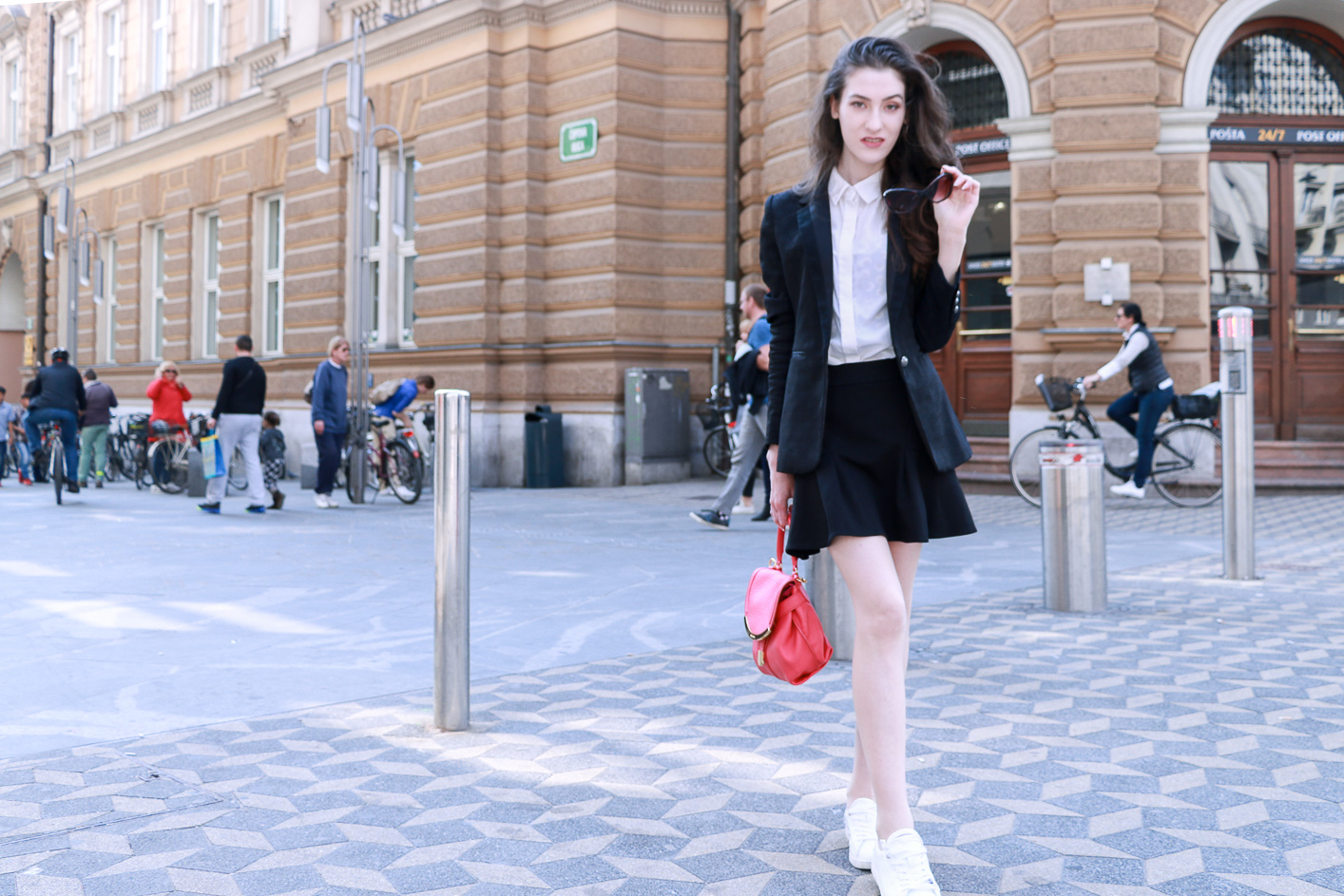 Fashion blogger Veronika Lipar of Brunette From Wall Street sharing her favourite skater skirt outfits to wear on the streets