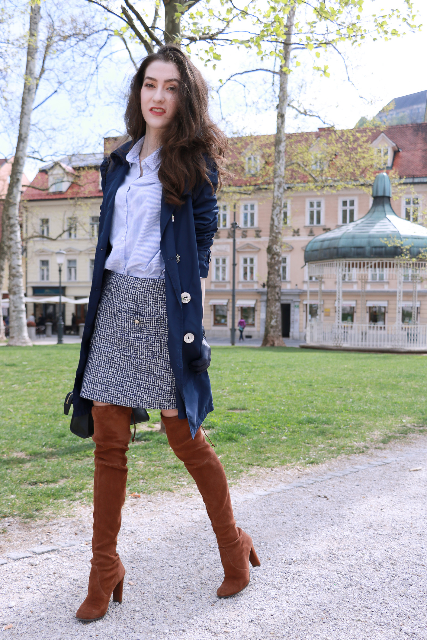 Fashion blogger Veronika Lipar of Brunette From Wall Street sharing how to style over the knee boots in summer