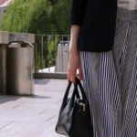 Fashion blogger Veronika Lipar of Brunette From Wall Street sharing how to wear striped pants relaxed suit