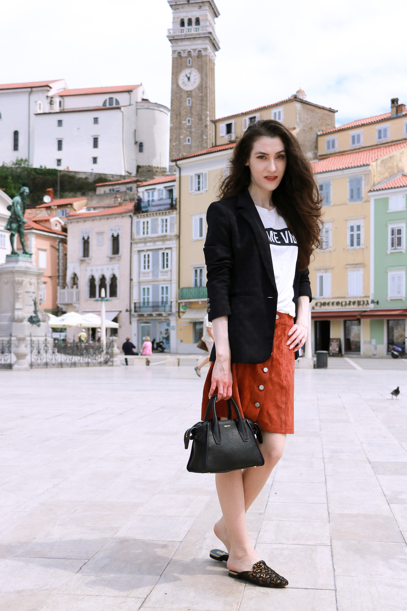 Fashion blogger Veronika Lipar of Brunette From Wall Street sharing how to wear slogan tee, mini brown suede skirt and black slippers to breakfast with girlfriends this summer