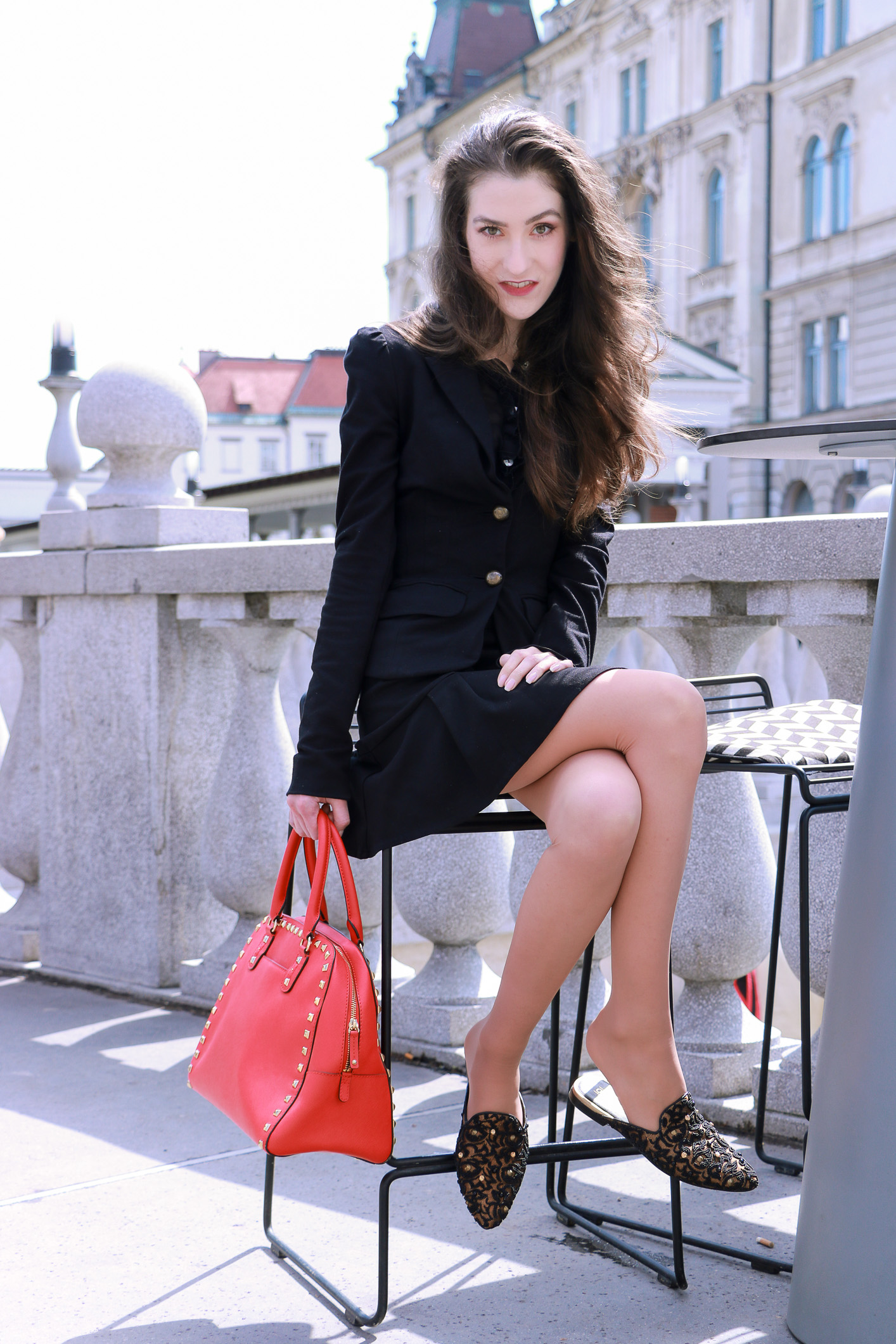 Fashion blogger Veronika Lipar of Brunette From Wall Street sharing fashionable business casual style in pinched blazer and mini skirt