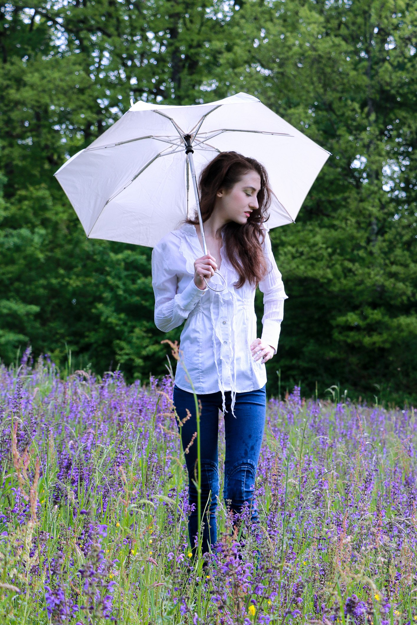 Fashion blogger Veronika Lipar of Brunette From Wall Street staring in makeup story Singing in the Rain holding an umbrella and standing in the morning rain wearing rainbow makeup