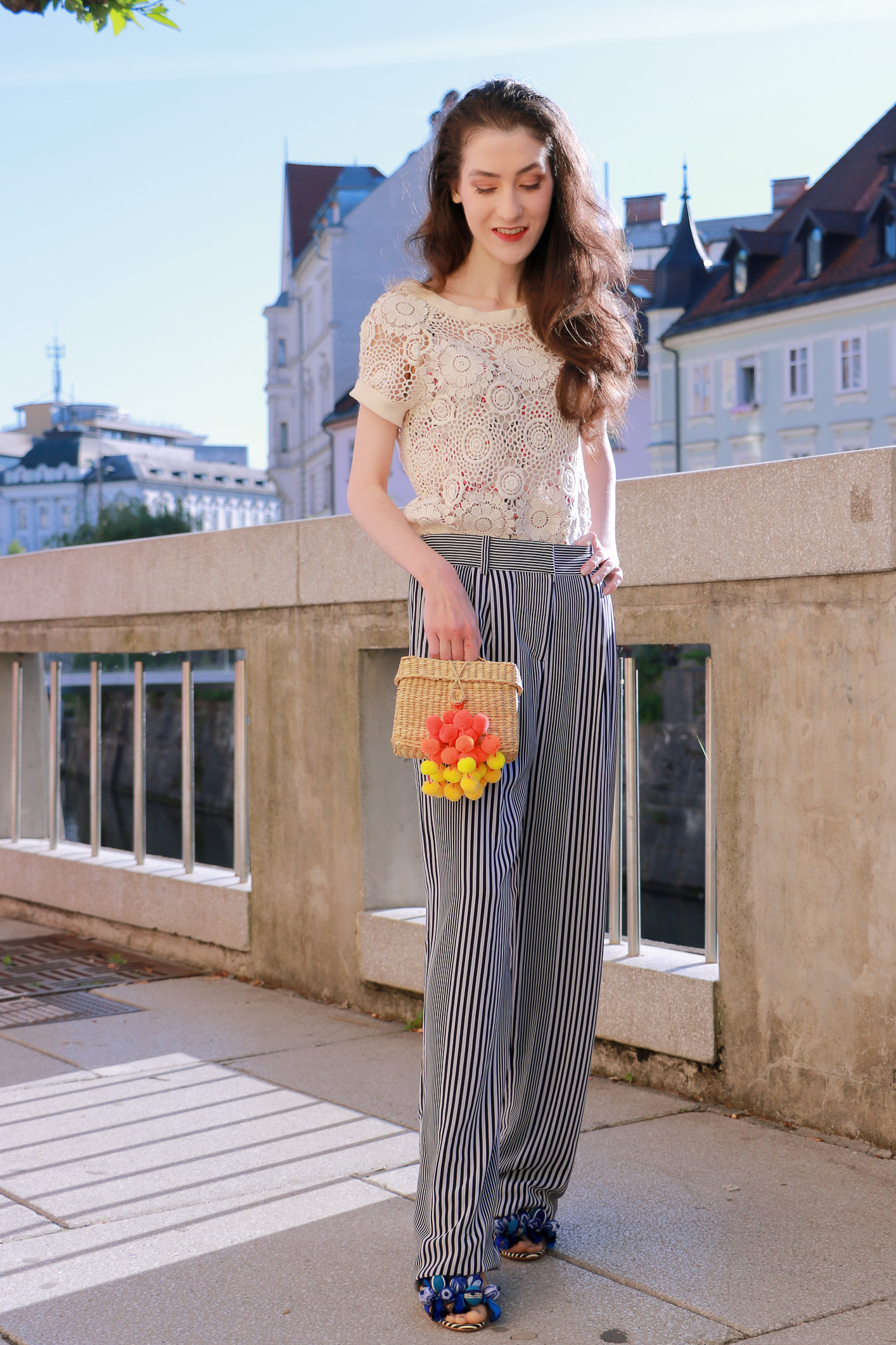 Fashion blogger Veronika Lipar of Brunette From Wall Street sharing how to wear raffia basket bag on the streets