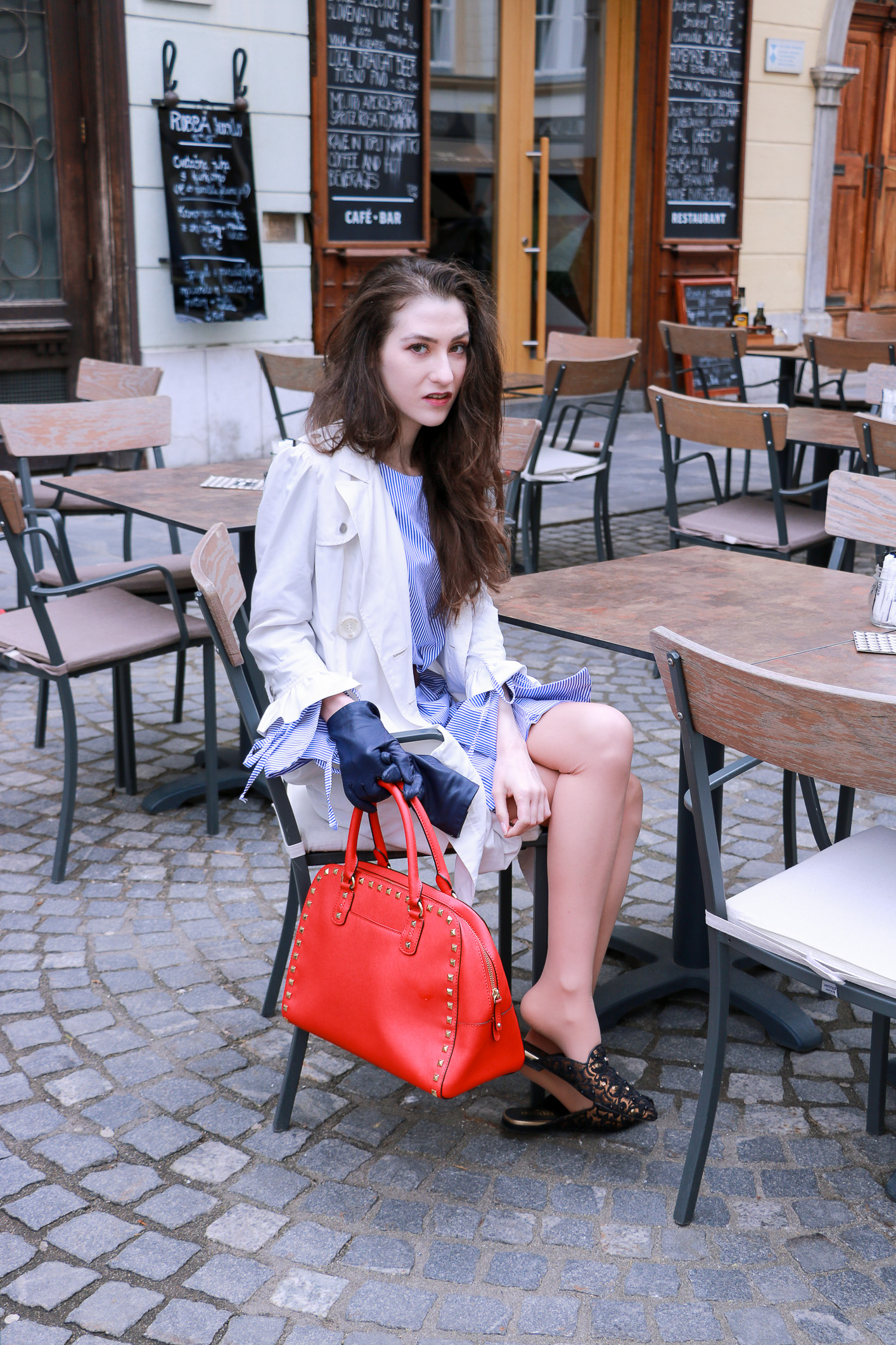 Fashion blogger Veronika Lipar of Brunette From Wall Street sharing how to wear shirt dress and slippers to lunch with girlfriends this spring