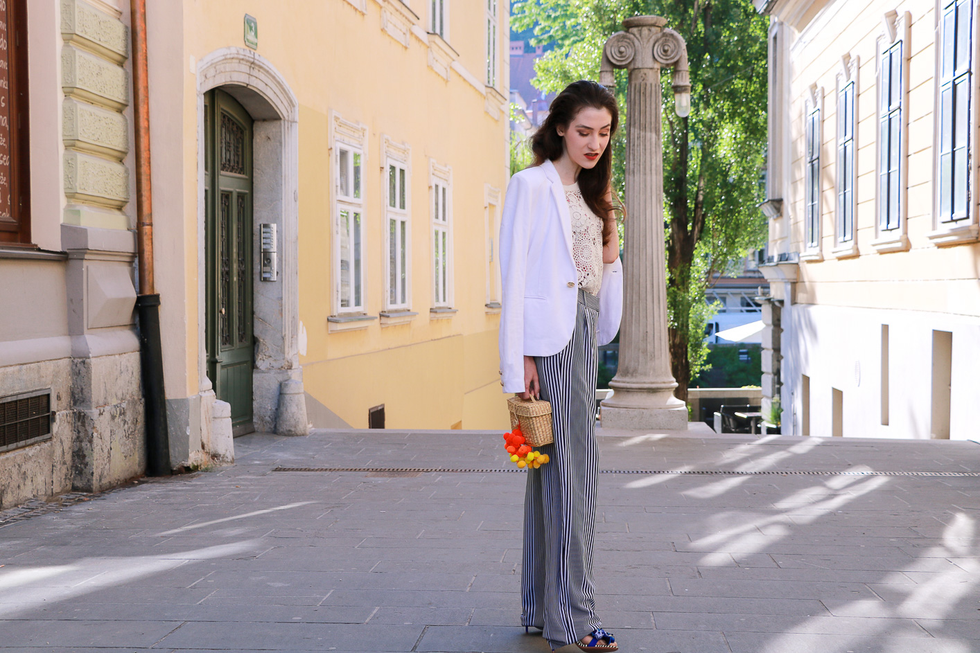 Fashion blogger Veronika Lipar of Brunette From Wall Street sharing how to wear raffia basket bag in the city