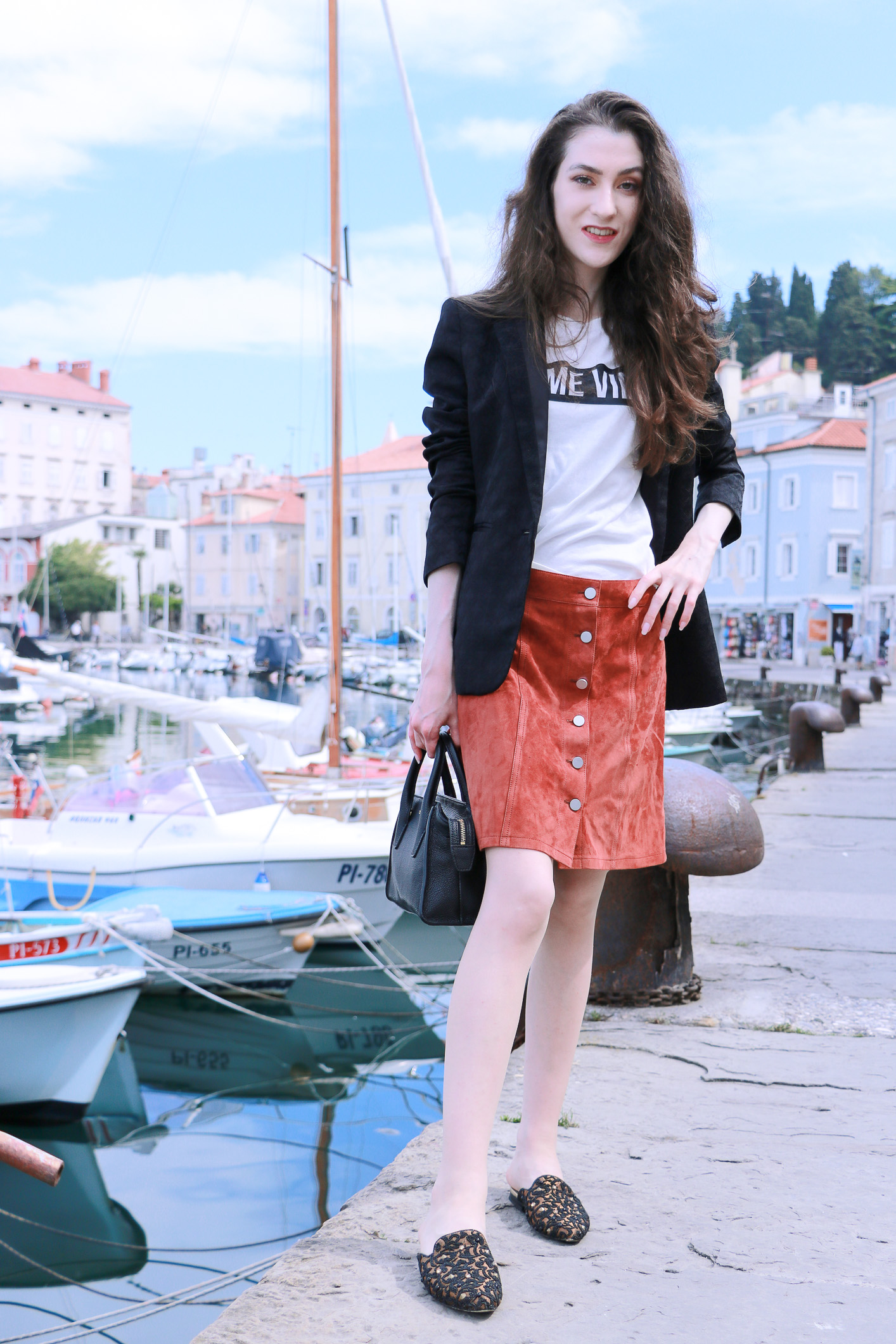 Fashion blogger Veronika Lipar of Brunette From Wall Street sharing her summer street style on the streets of the old romantic seaside town Piran