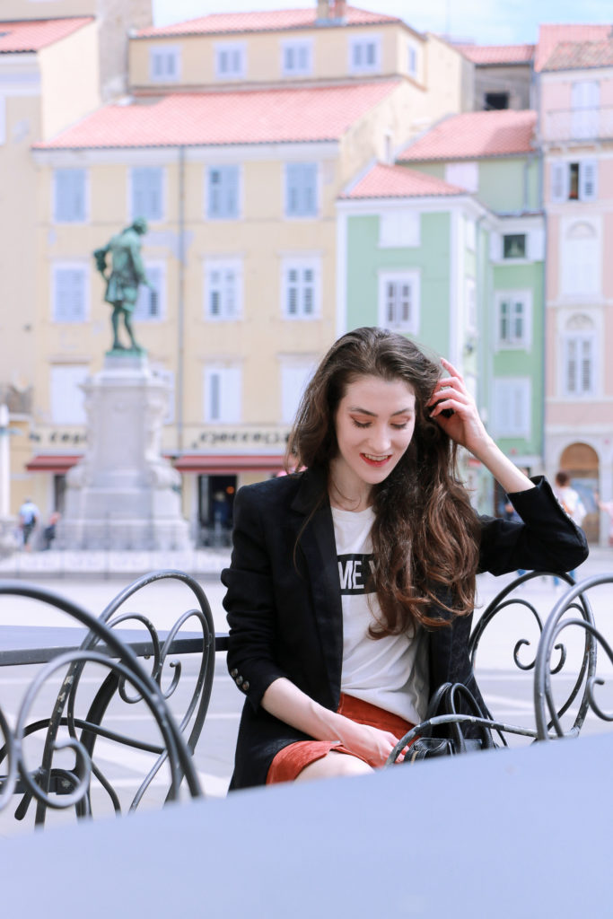 Fashion blogger Veronika Lipar of Brunette From Wall Street sitting at the Tartini Square