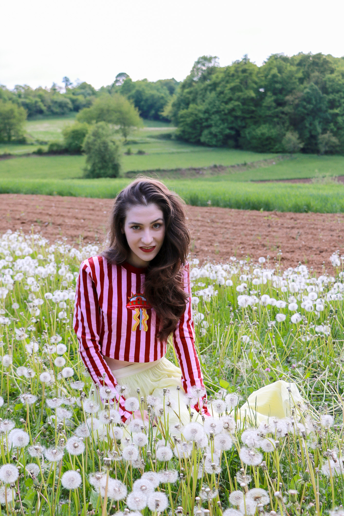 Fashion blogger Veronika Lipar of Brunette From Wall Street sharing romantic spring hairstyle and makeup for a spring festival