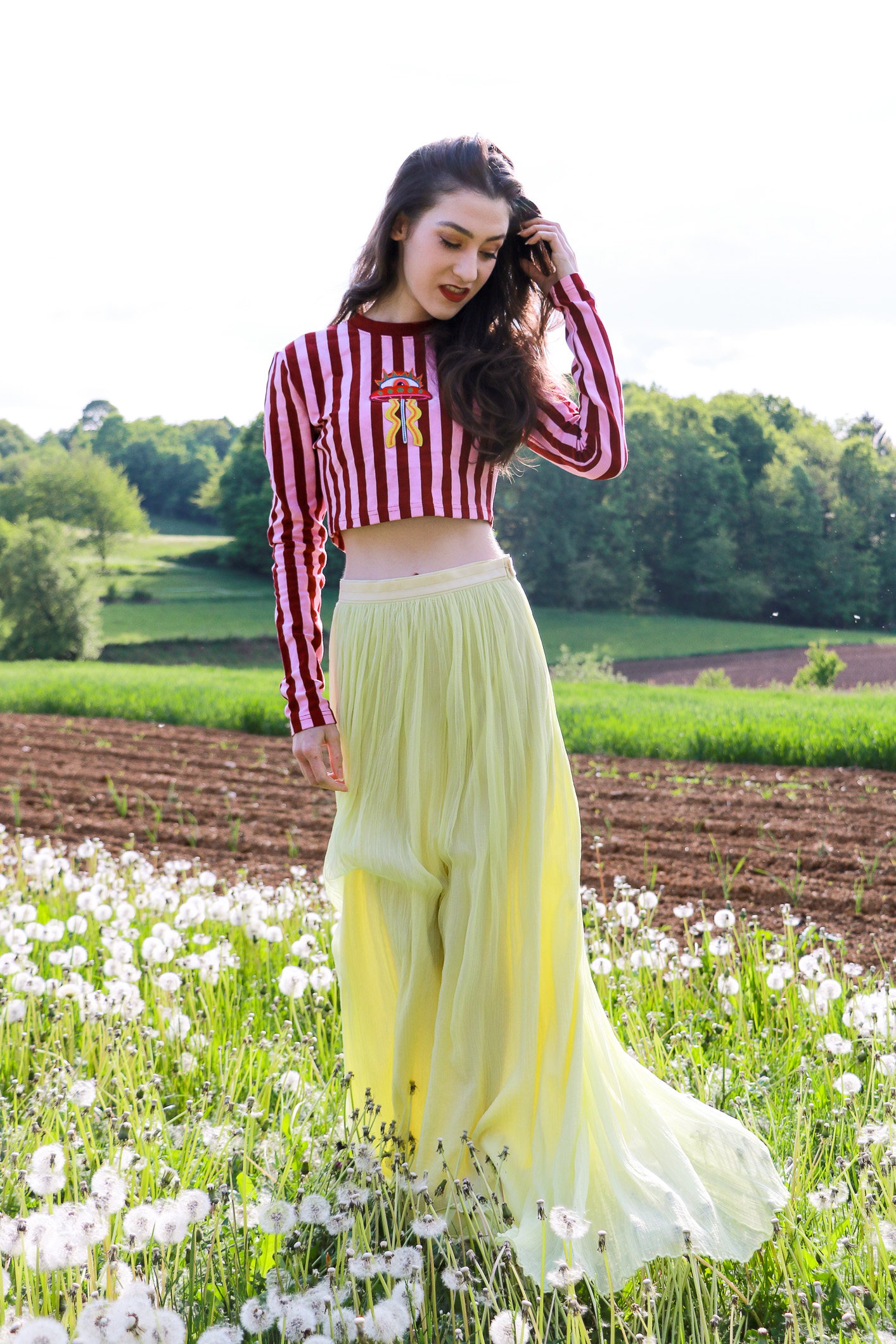 Fashion blogger Veronika Lipar of Brunette From Wall Street sharing how to style yellow outfit this season