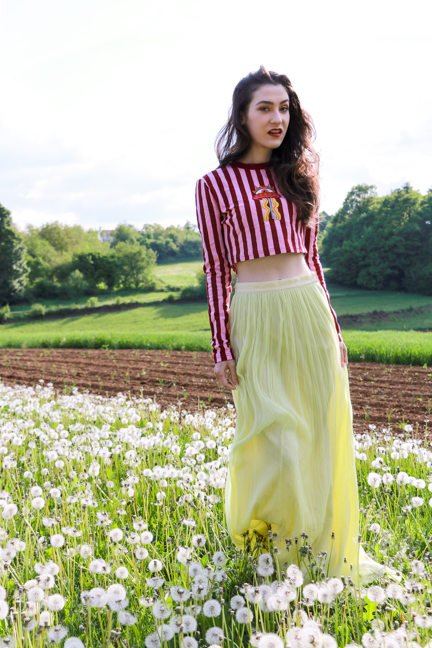 Fashion blogger Veronika Lipar of Brunette From Wall Street sharing how to wear long tulle skirt this spring