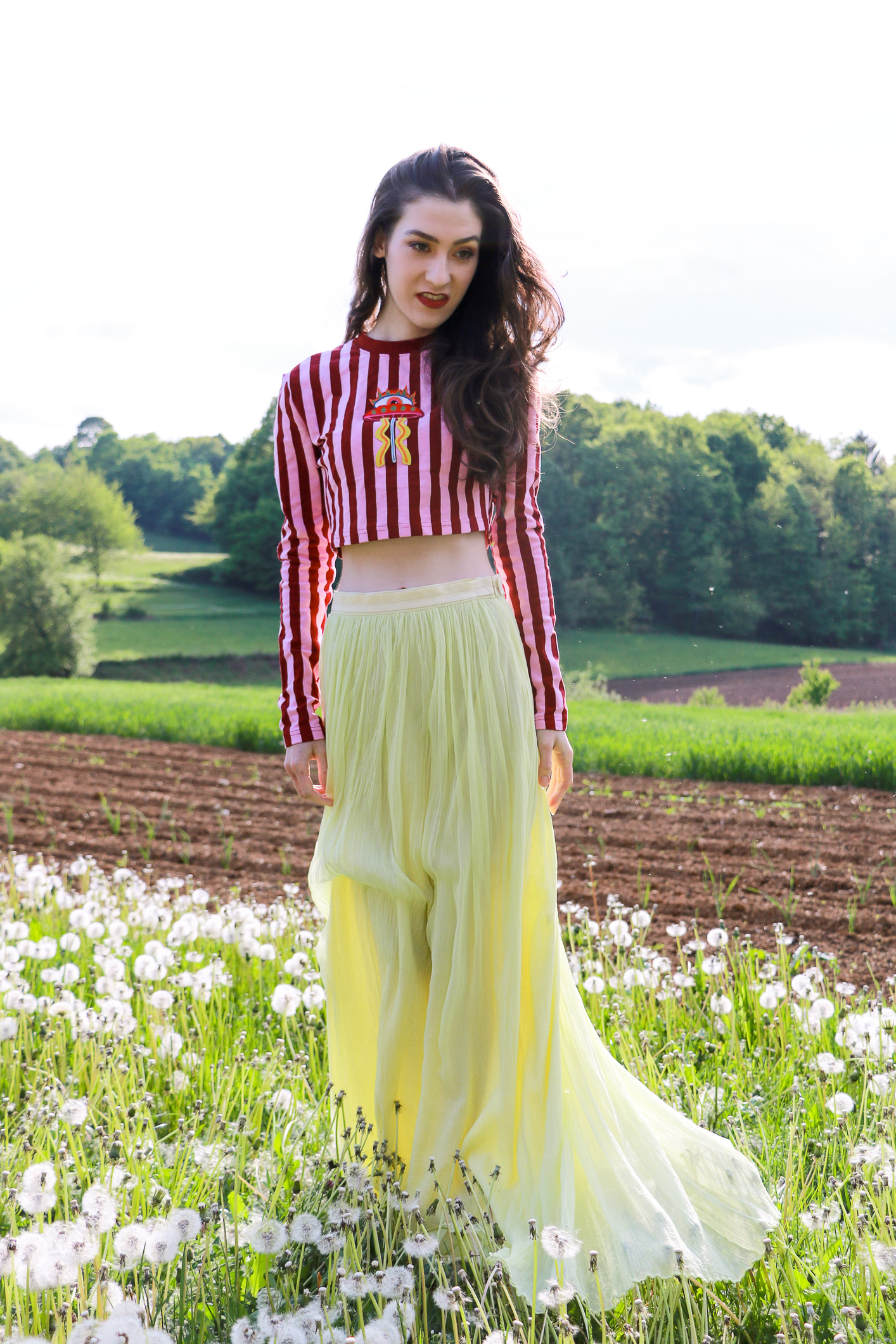 Fashion blogger Veronika Lipar of Brunette From Wall Street sharing how to wear yellow outfit this season