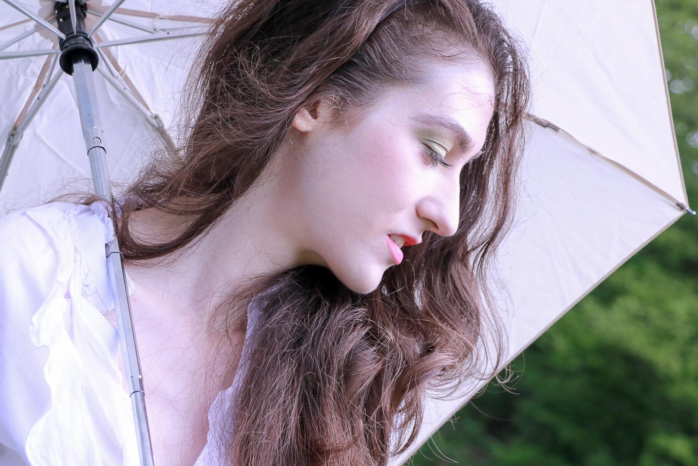Fashion blogger Veronika Lipar of Brunette From Wall Street staring in makeup story Singing in the Rain holding an umbrella and standing in the morning rain wearing spring makeup